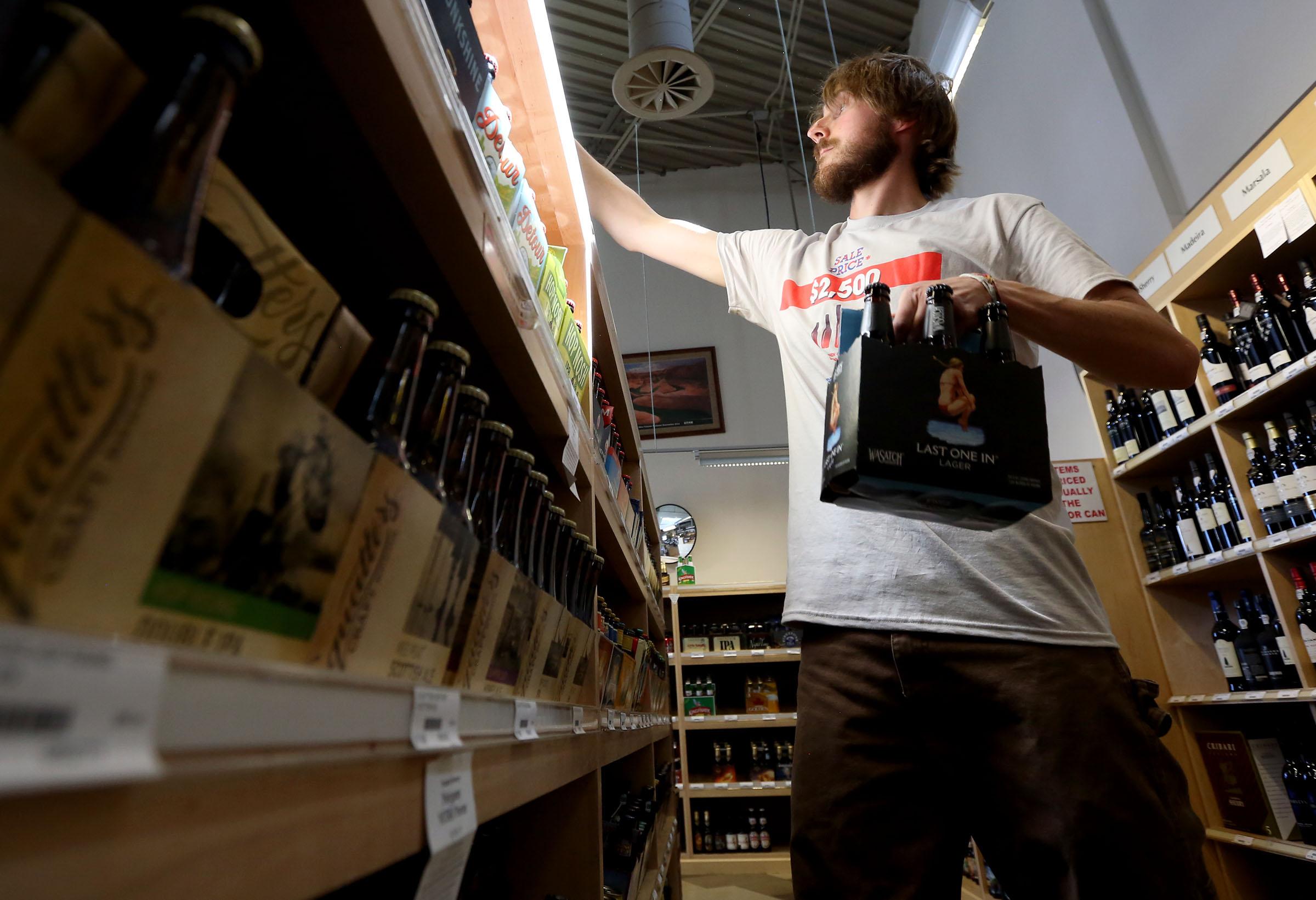 Glen Simister stocks beer at the Utah State Liquor Store in Holladay on Thursday, July 2, 2015.
