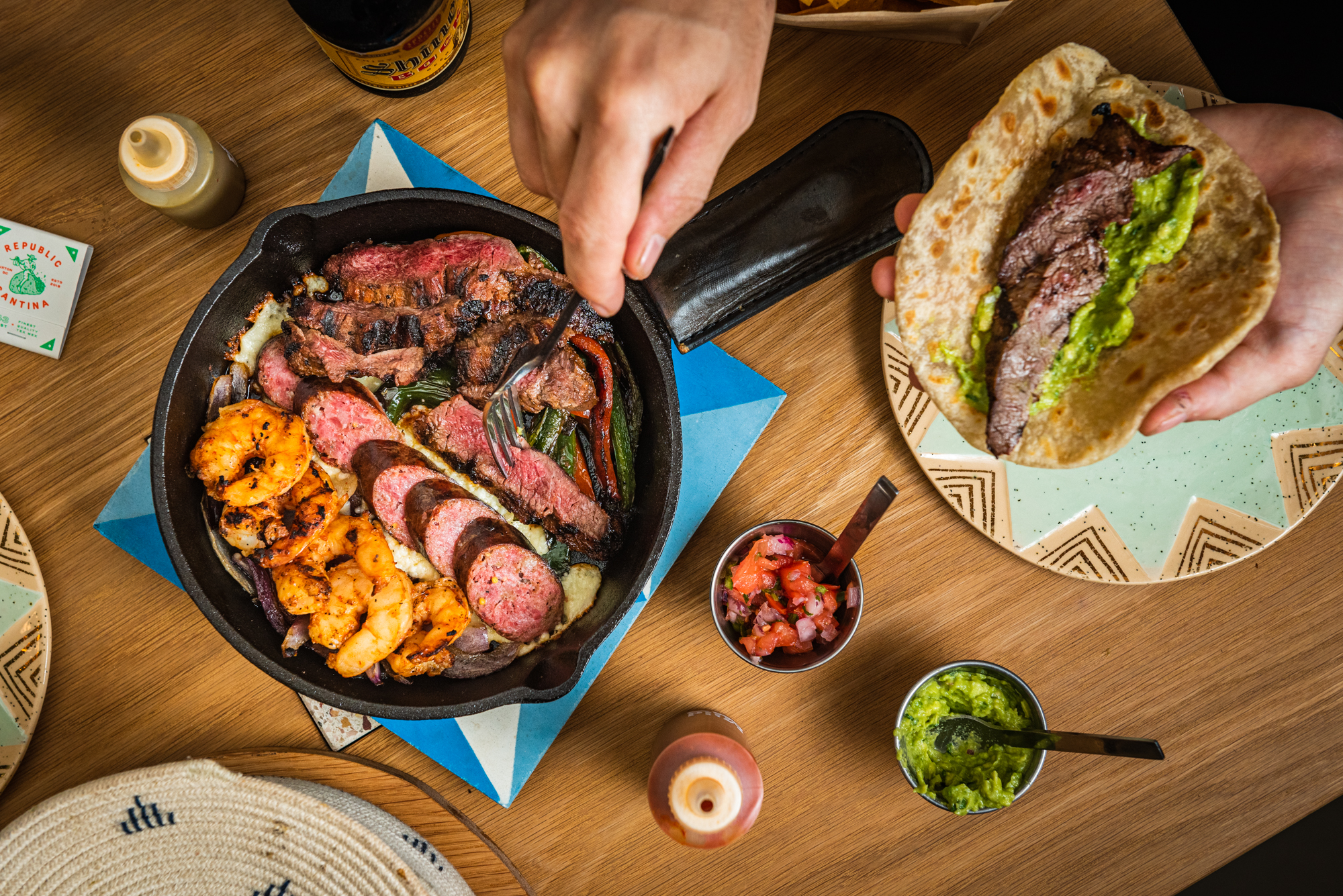 A fajita platter from Republic Cantina that includes shrimp with Old Bay bacon butter, Czech sausage, and gochujang-marinated beef.