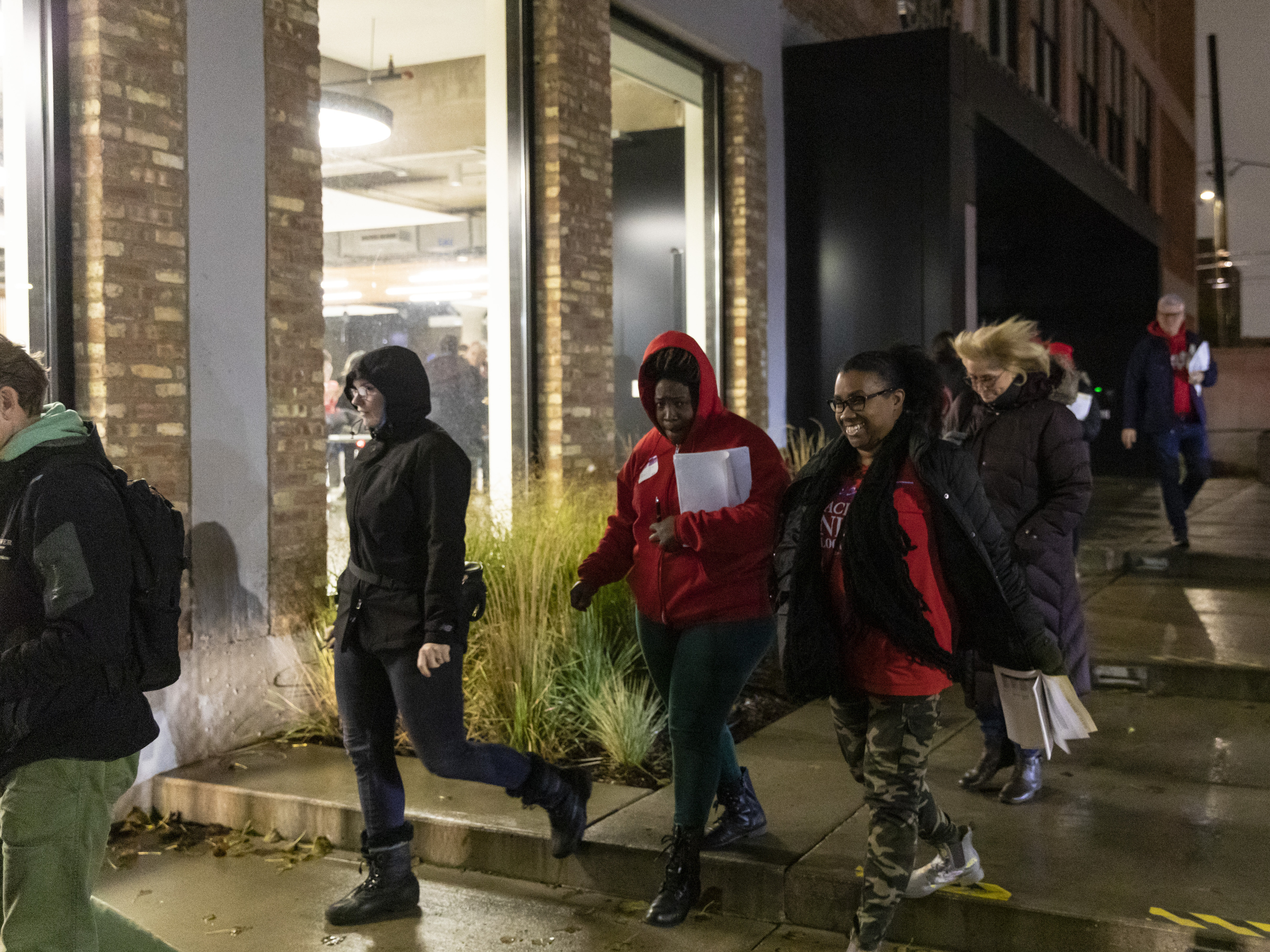 Members of the Chicago Teachers Union's governing body walk out of the union's Near West Side headquarters on Wednesday night.