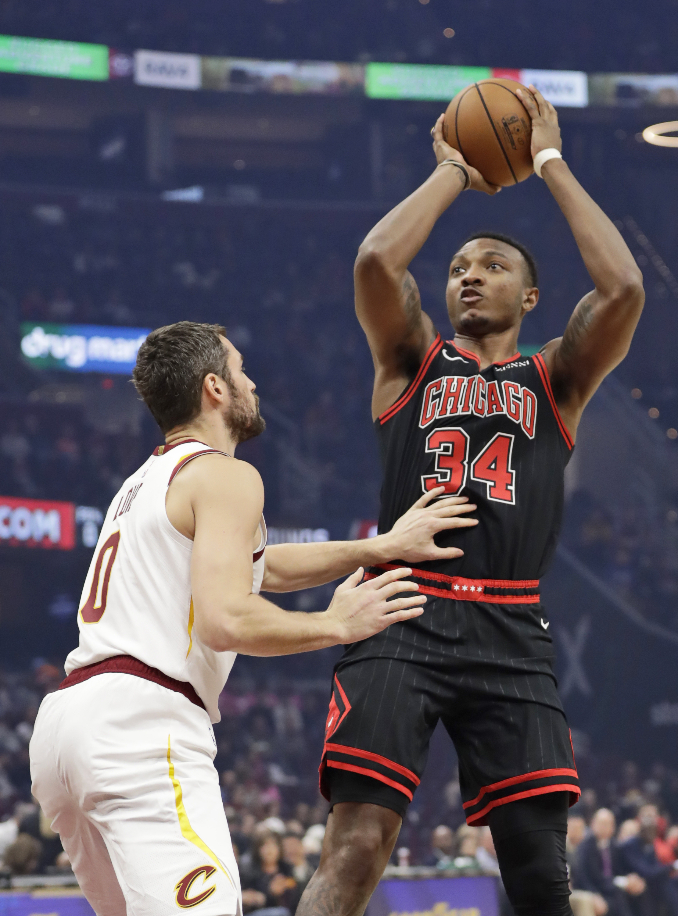 The Bulls' Wendell Carter Jr. shoots over the Cavaliers' Kevin Love during Wednesday's game in Cleveland.