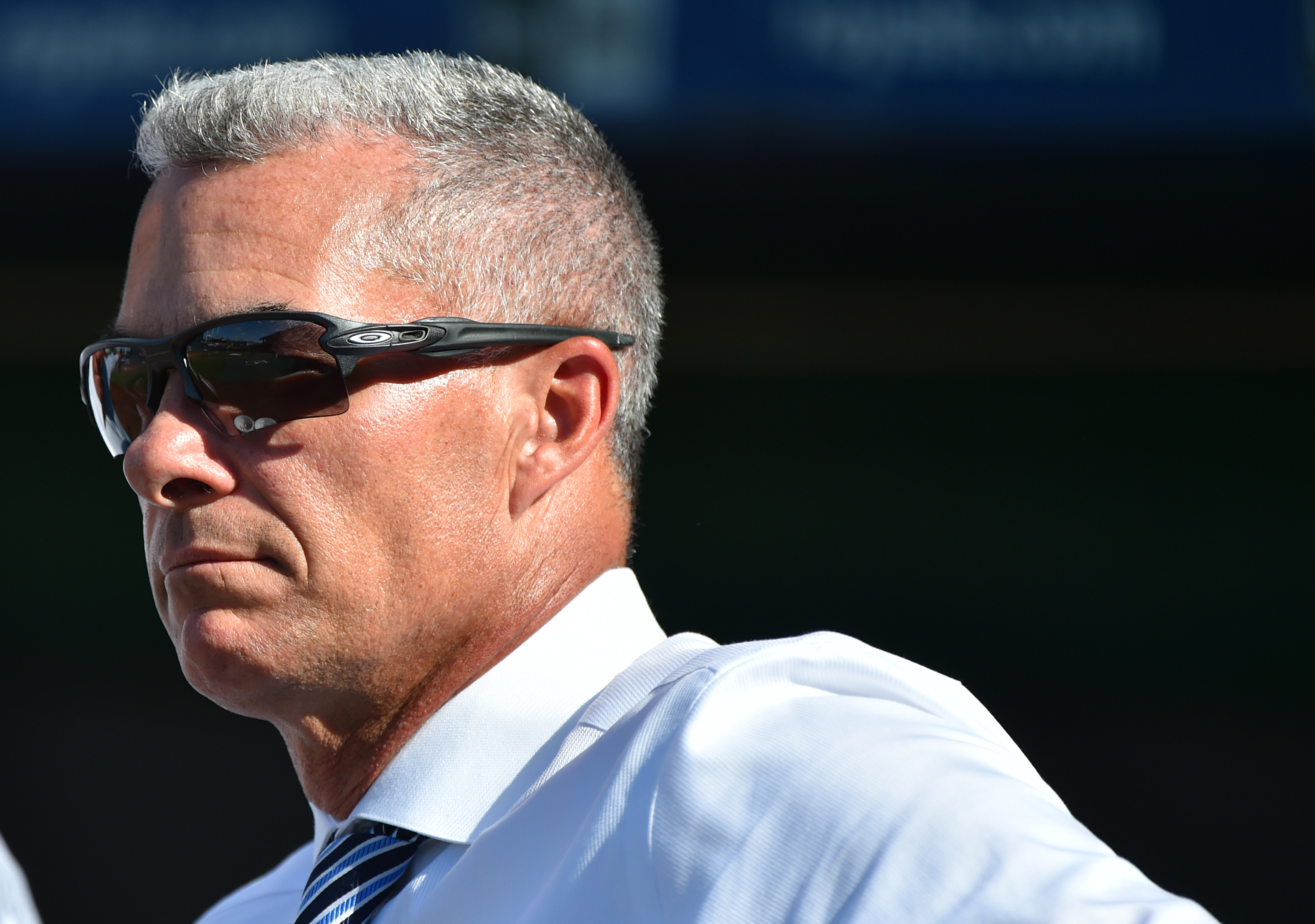 General manager Dayton Moore of the Kansas City Royals watches batting practice prior to a game against the Baltimore Orioles at Kauffman Stadium on August 30, 2019 in Kansas City, Missouri.