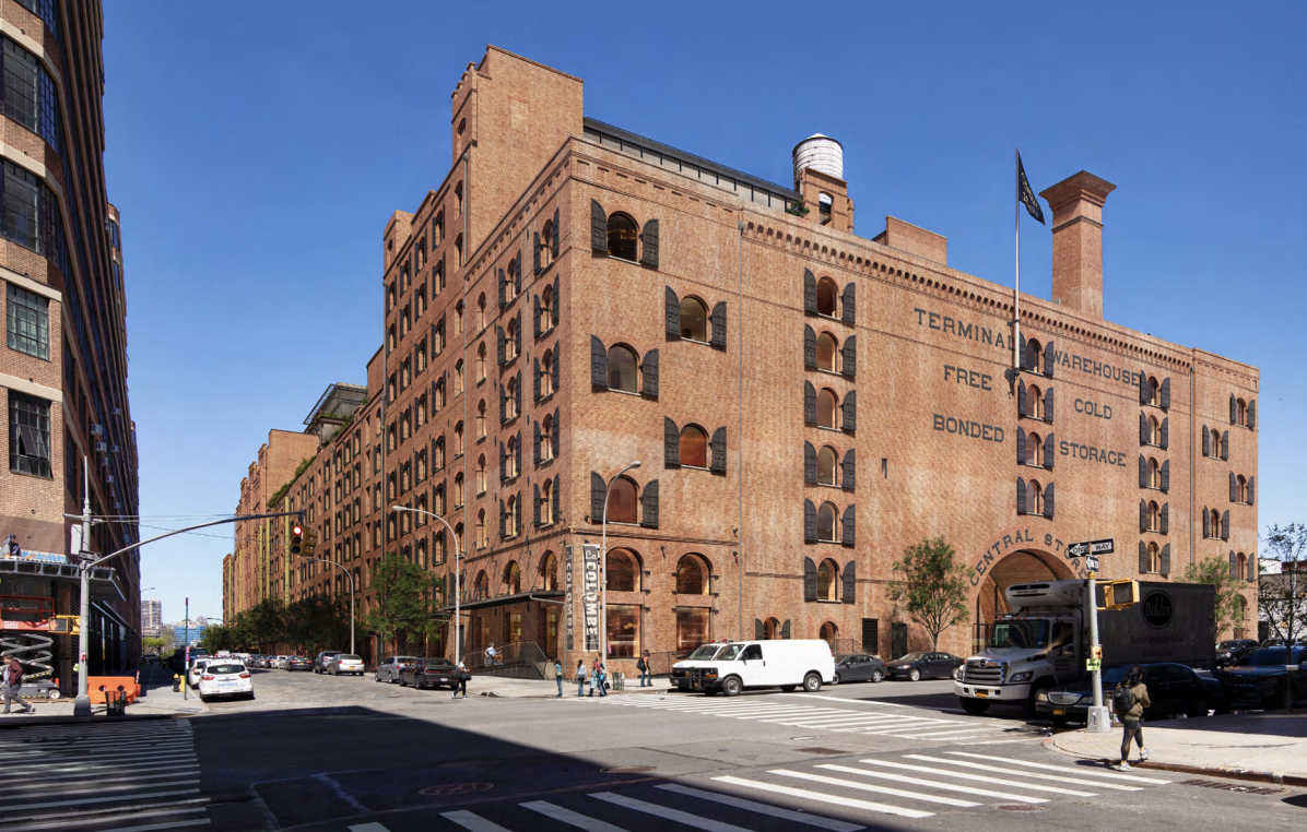 A brick warehouse sits in the corner of a Chelsea street.