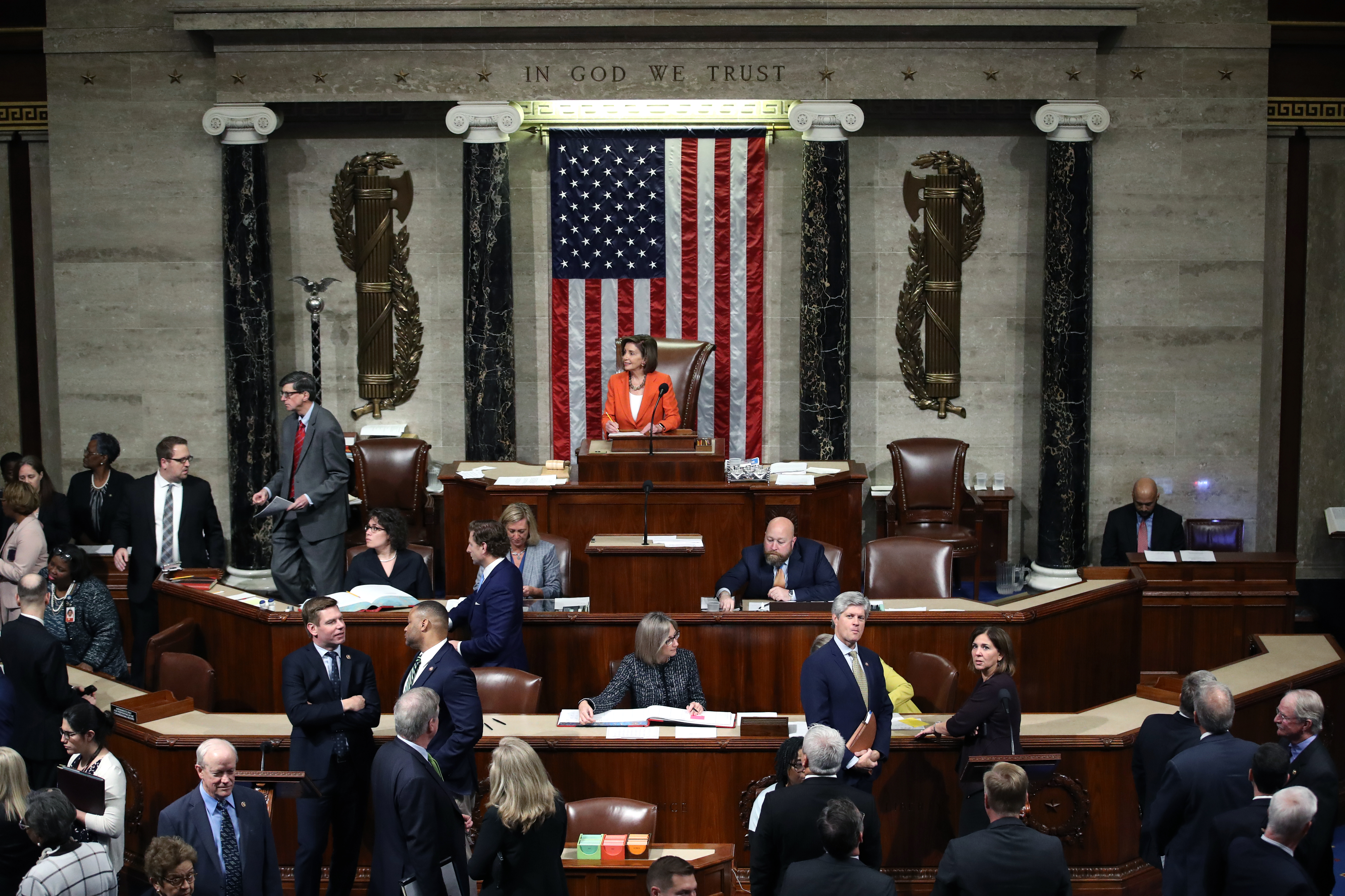 Speaker of the House, U.S. Rep. Nancy Pelosi presides over the U.S. House of Representatives as it votes on a resolution formalizing the impeachment inquiry centered on President Donald Trump on Thursday.