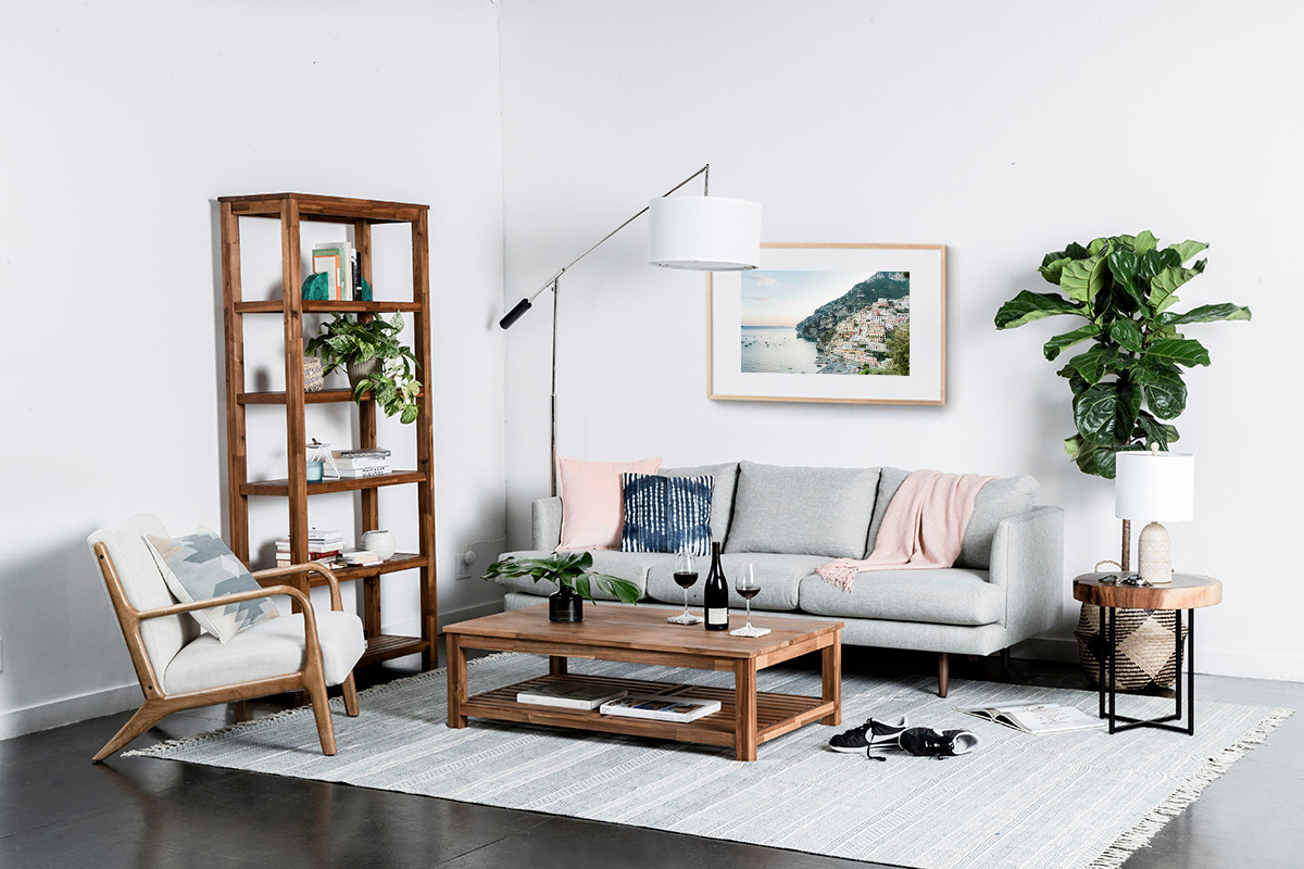 Living room with gray sofa, wooden coffee table, and plants.