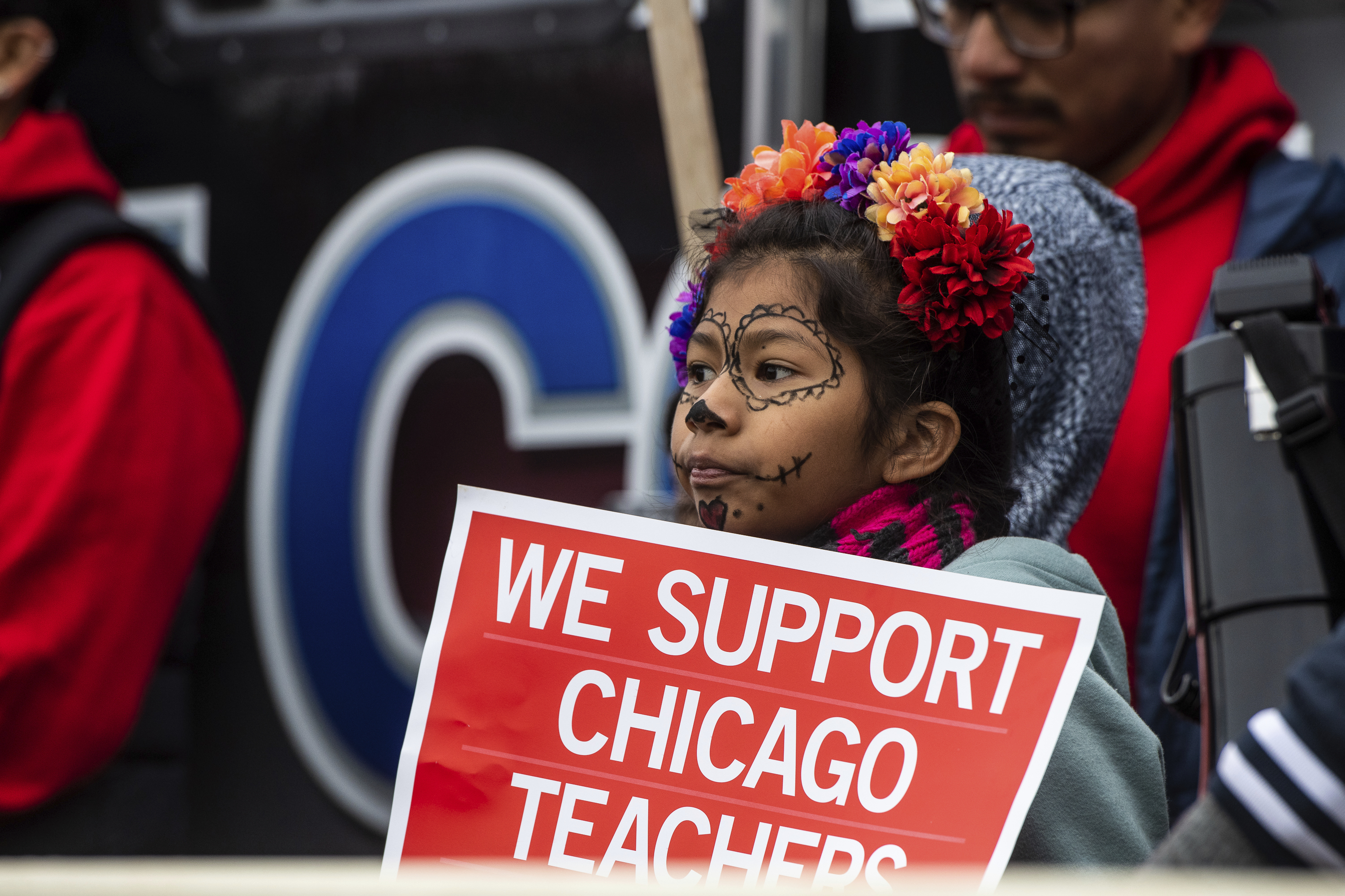 A child holds a sign at a Chicago Teachers Union rally during the strike.
