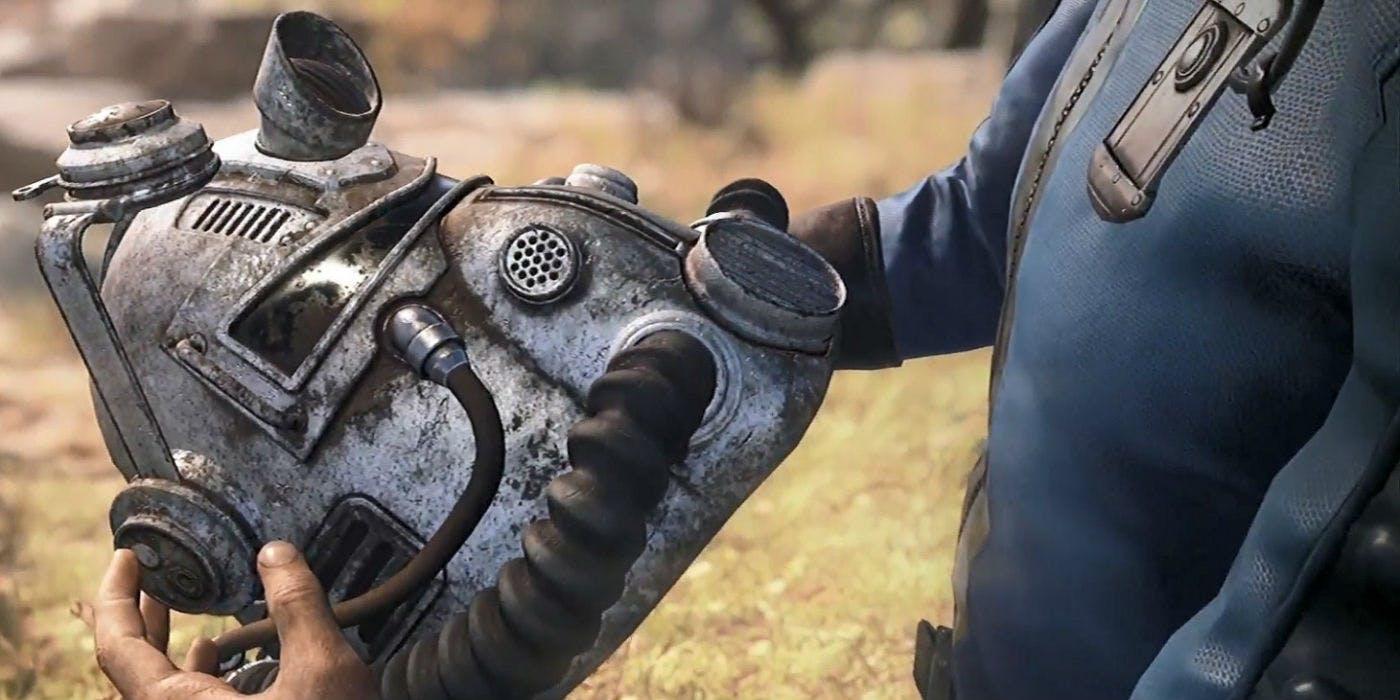 Fallout 76 - a Vault Dweller holds a Brotherhood of Steel helmet