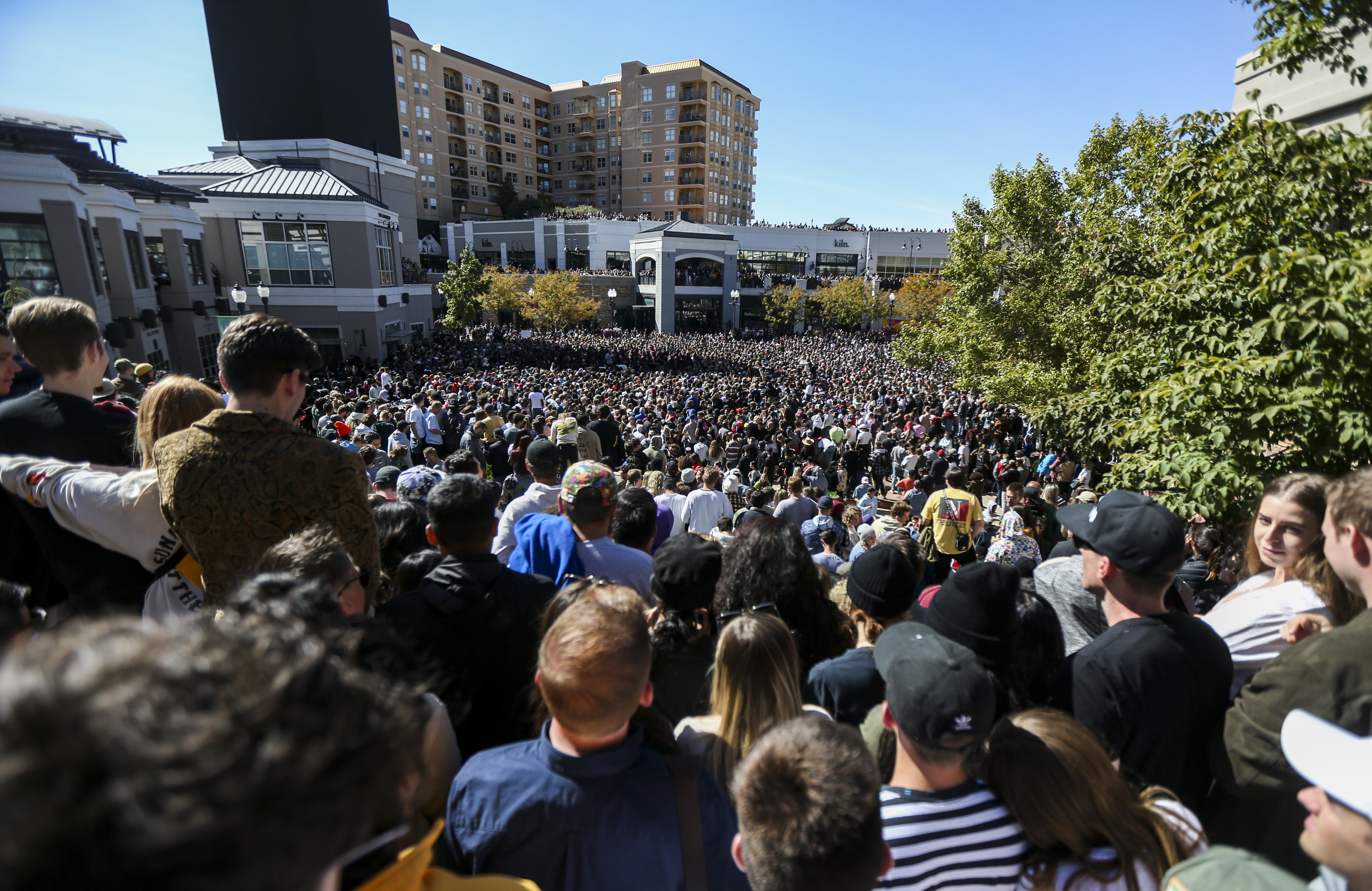 "Several thousand people pack into The Gateway mall in Salt Lake City for Kanye West's ""Sunday Service"" on Saturday, Oct. 5, 2019. People were standing on and climbing up anything they could find to catch a glimpse of West."