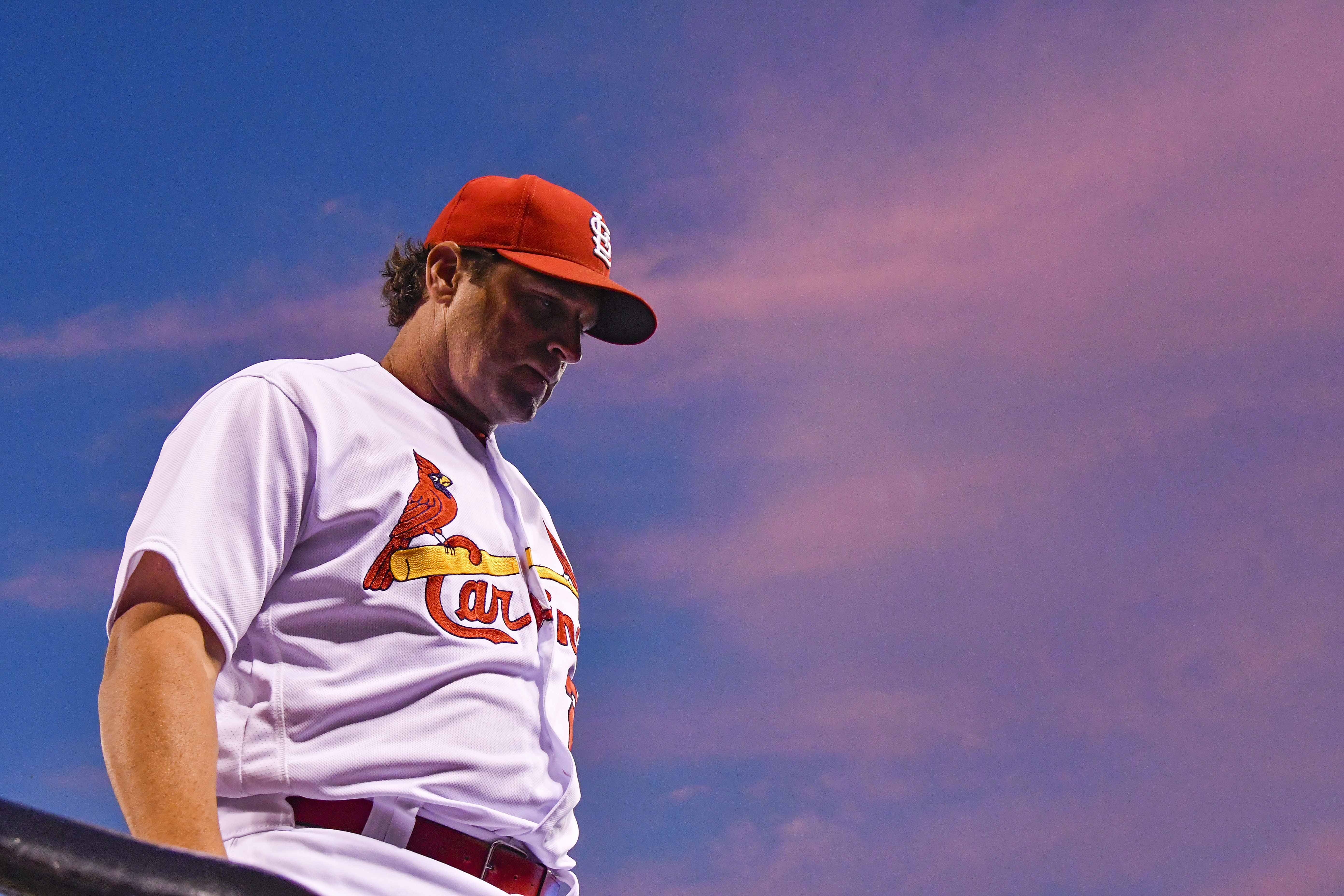 St. Louis Cardinals manager Mike Matheny (22) walks off the field after changing pitchers during the sixth inning against the Pittsburgh Pirates at Busch Stadium.
