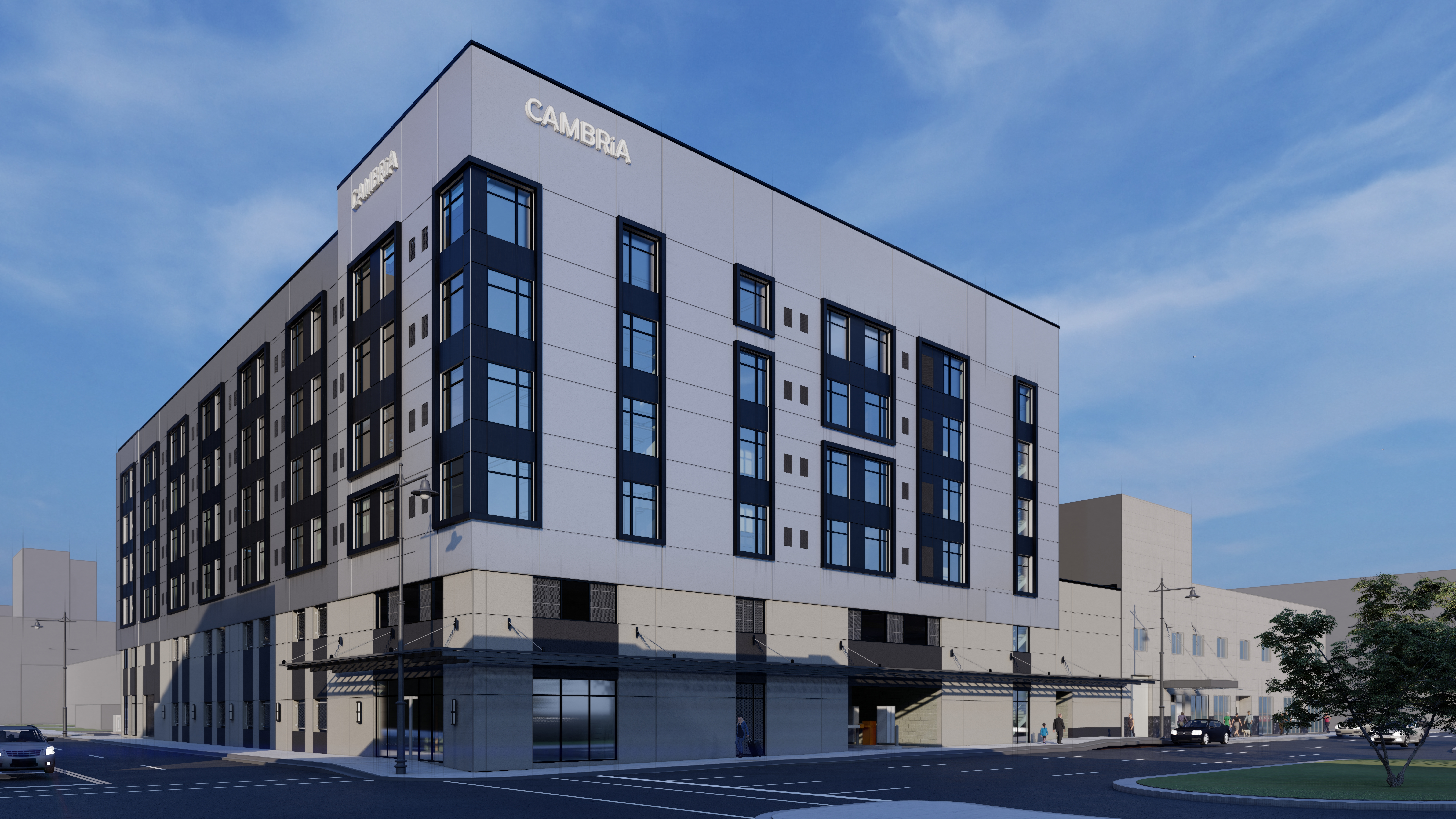 Exterior of a six-story hotel with modular design. There's panels of different colors around the windows.