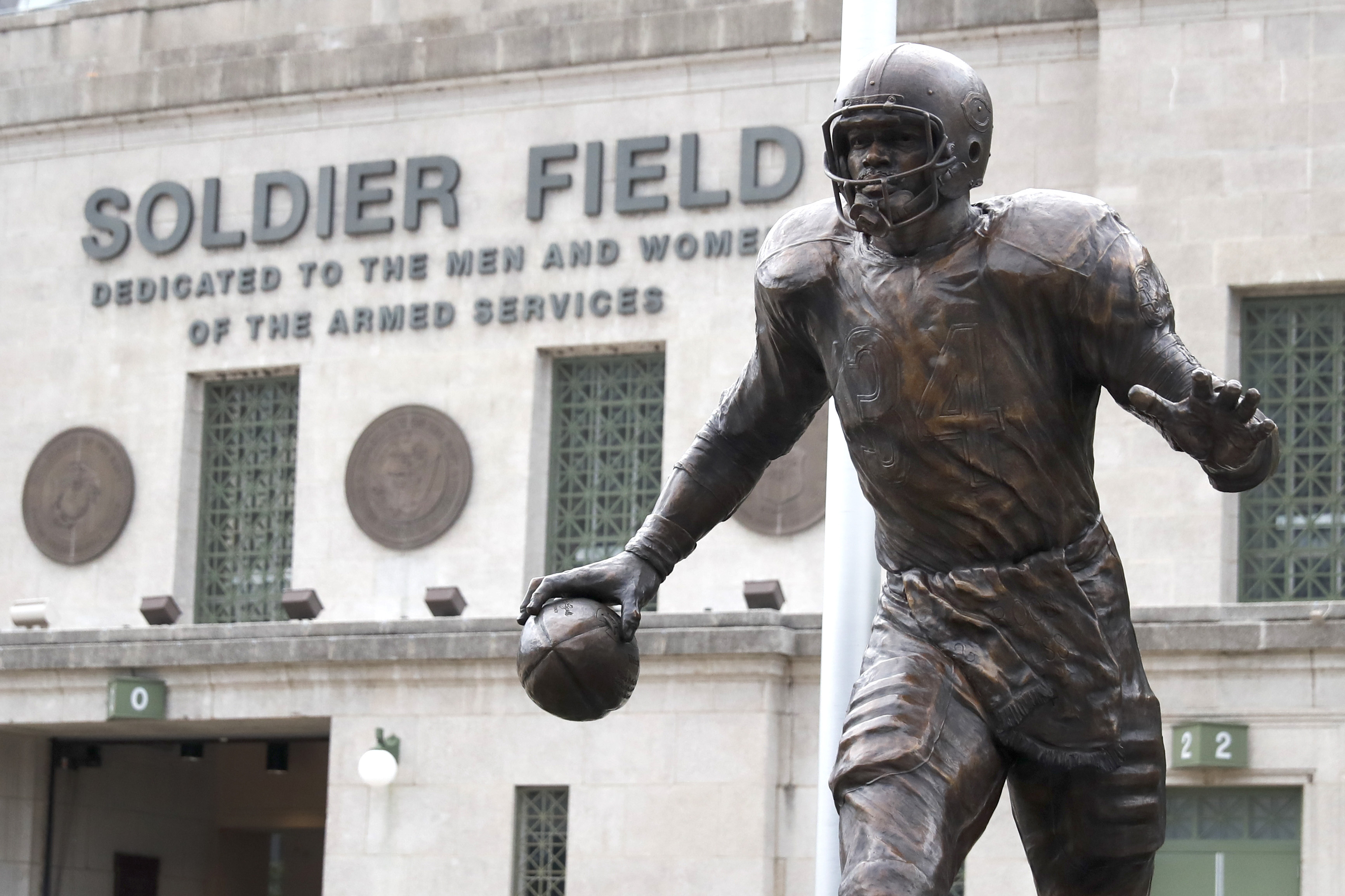 The newly dedicated statue of Chicago Bears and Pro Football Hall of Fame running back Walter Payton stands outside Soldier Field
