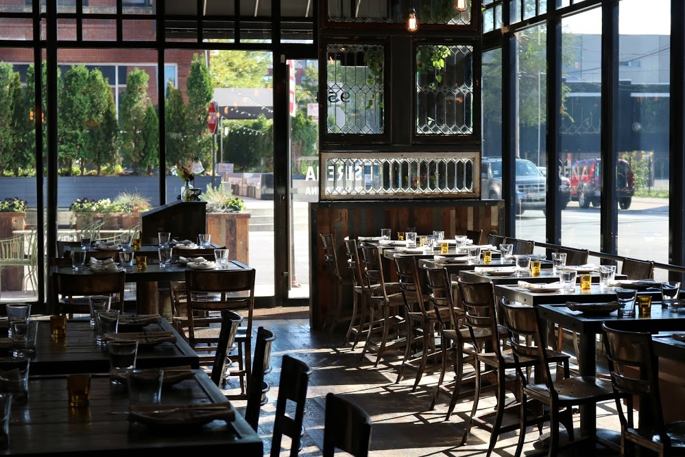 A bright dining room looking out to Chicago's Fulton Market.