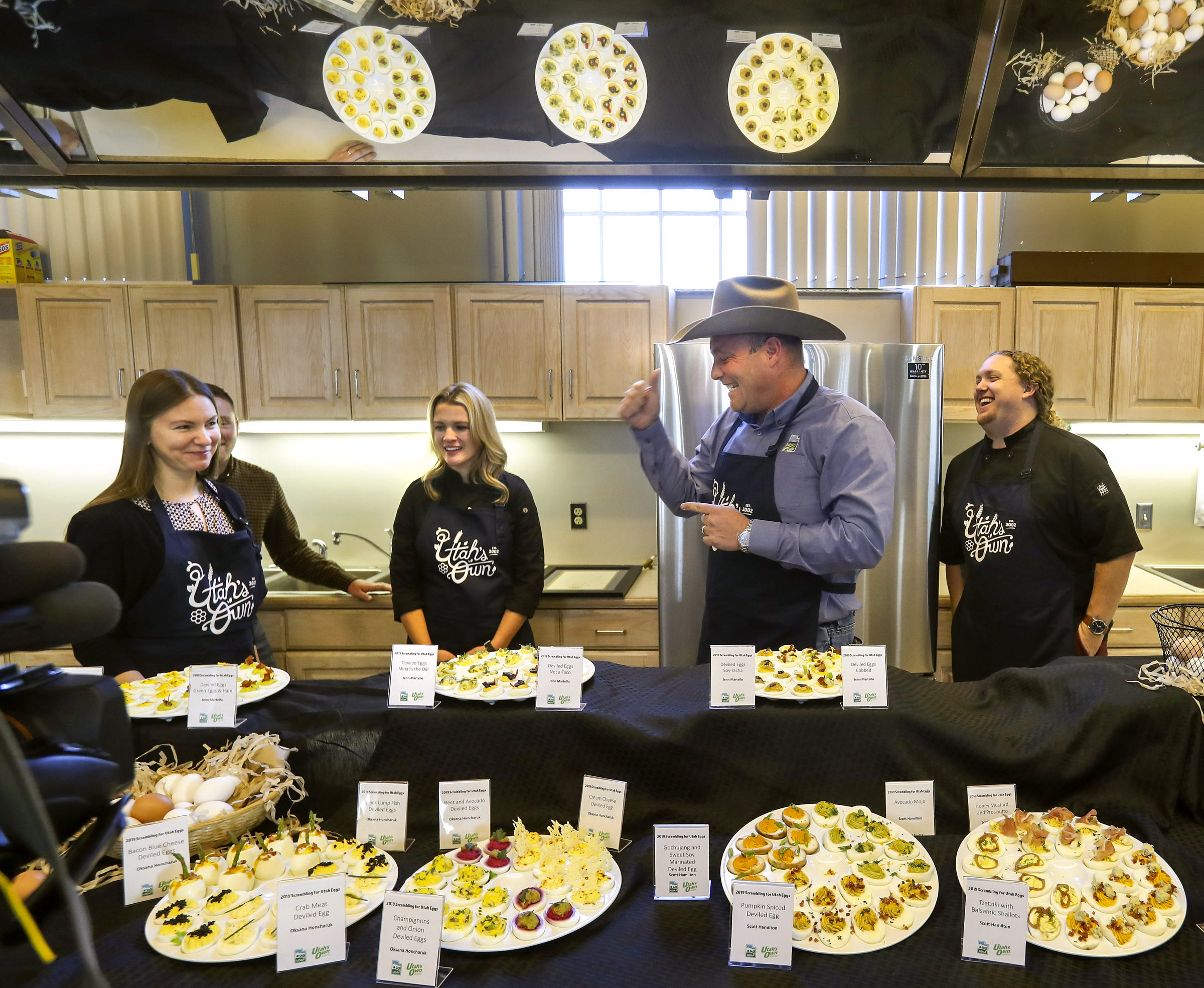 Kerry Gibson, commissioner of the Utah Department of Agriculture and Food, second from right, talks with local chefs Oksana Honcharuk, Jenn Martello and Scott Hamilton about their deviled egg recipes during a press conference promoting Utah Egg Producer Day at the Utah State Fairpark in Salt Lake City on Friday, Nov. 1, 2019. The event closely coincides with National Deviled Egg Day which is Nov. 2, 2019. Egg production has grown over the years and contributes an estimated $75 million to Utah's economy.