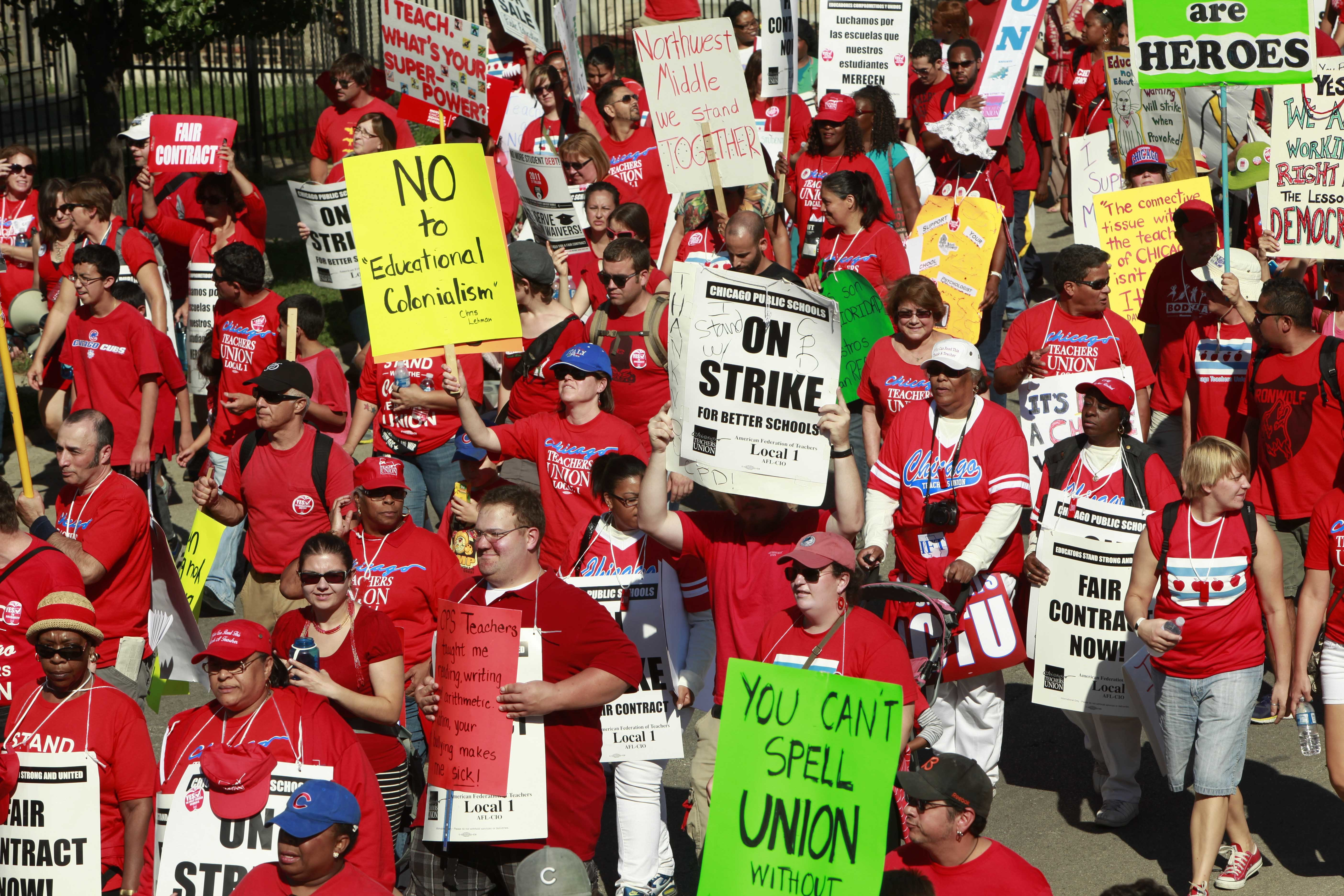 Striking Chicago school teachers march after a rally in September 2012 in Chicago.