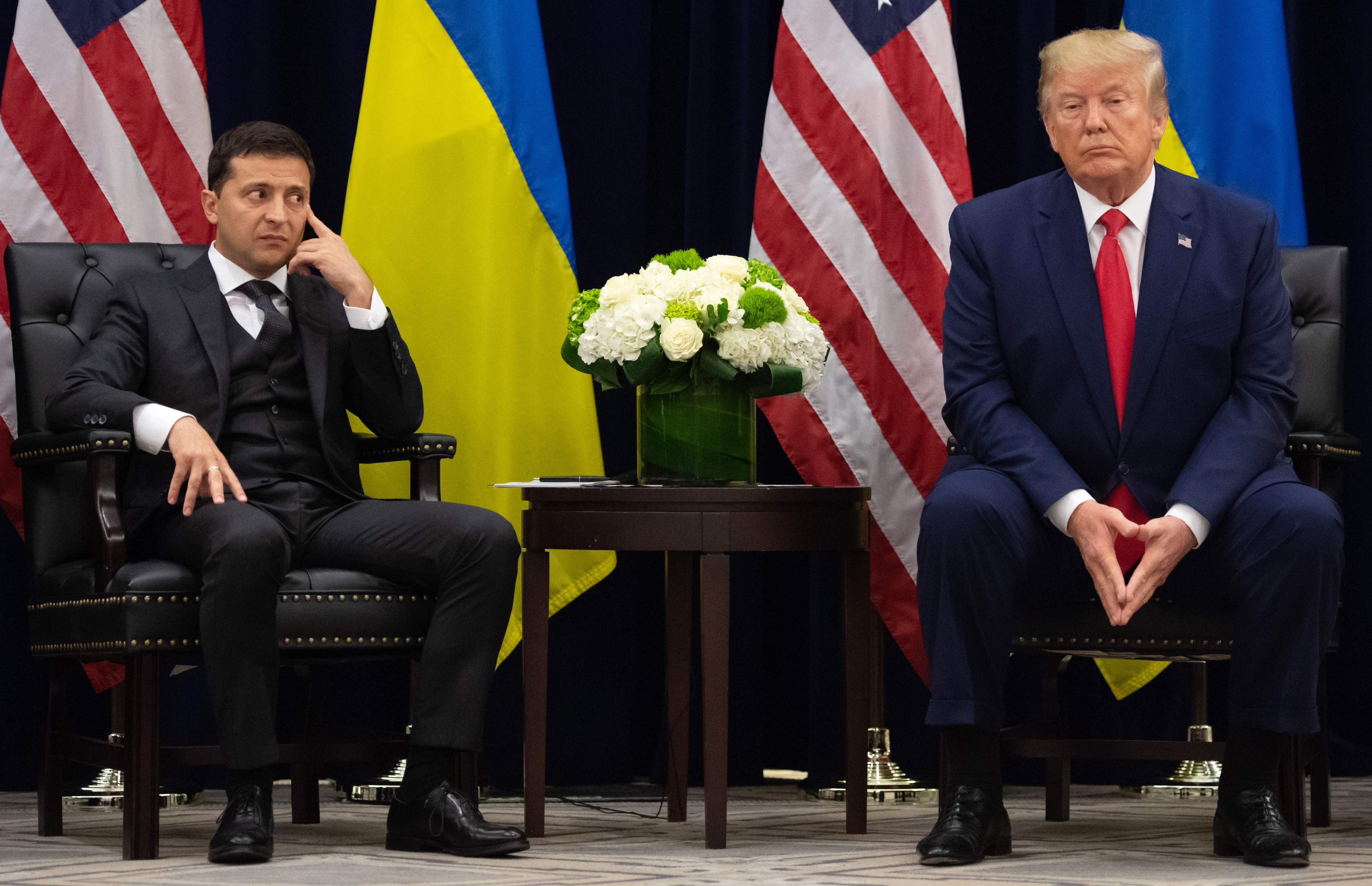 In this file photo taken on September 25, 2019 US President Donald Trump and Ukrainian President Volodymyr Zelensky looks on during a meeting in New York on the sidelines of the United Nations General Assembly.