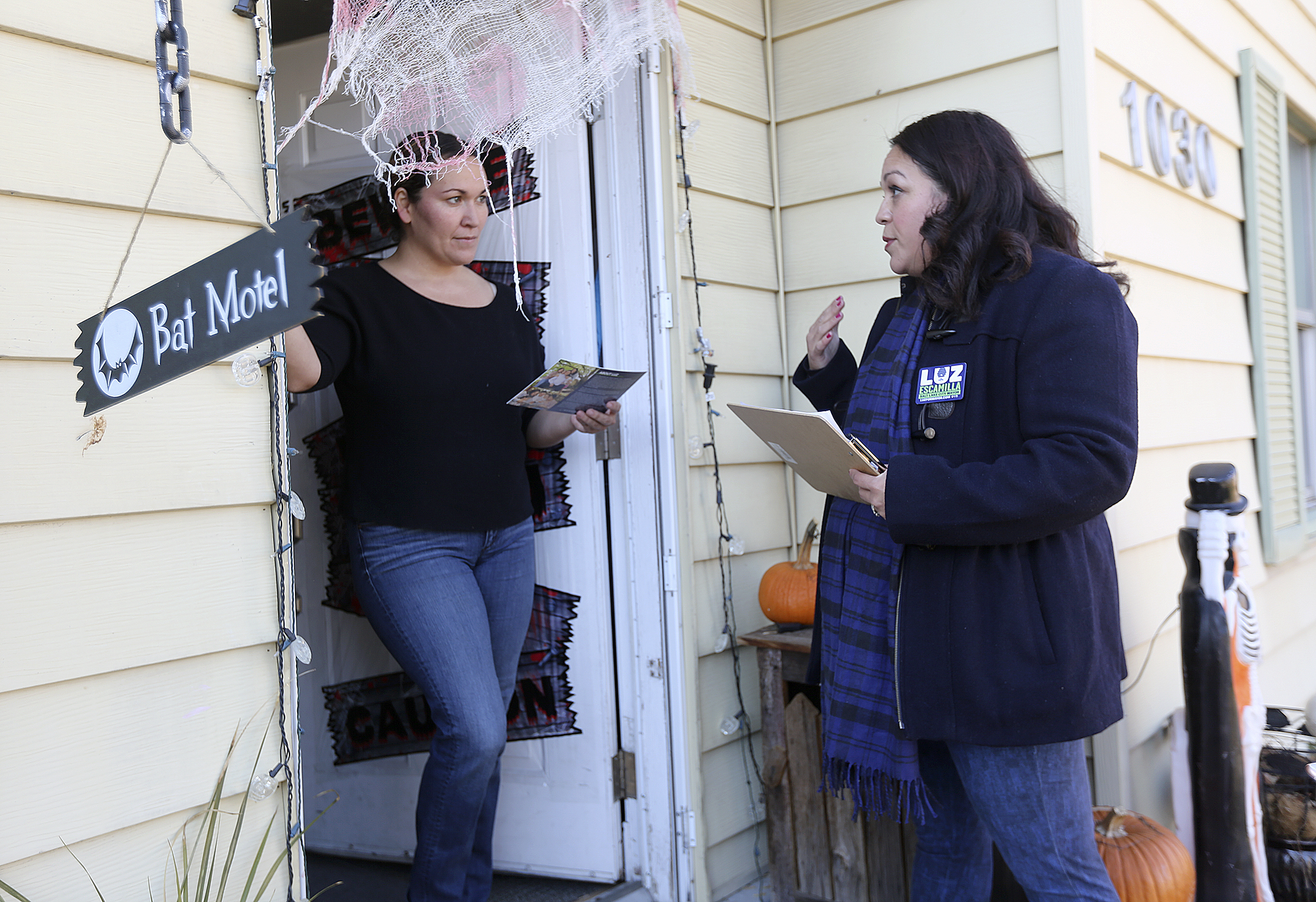 Salt Lake City mayoral candidate and state senator Luz Escamilla talks with Erika Riggs, left, while knocking on doors in the Glendale neighborhood of Salt Lake City on Friday, Nov. 1, 2019.
