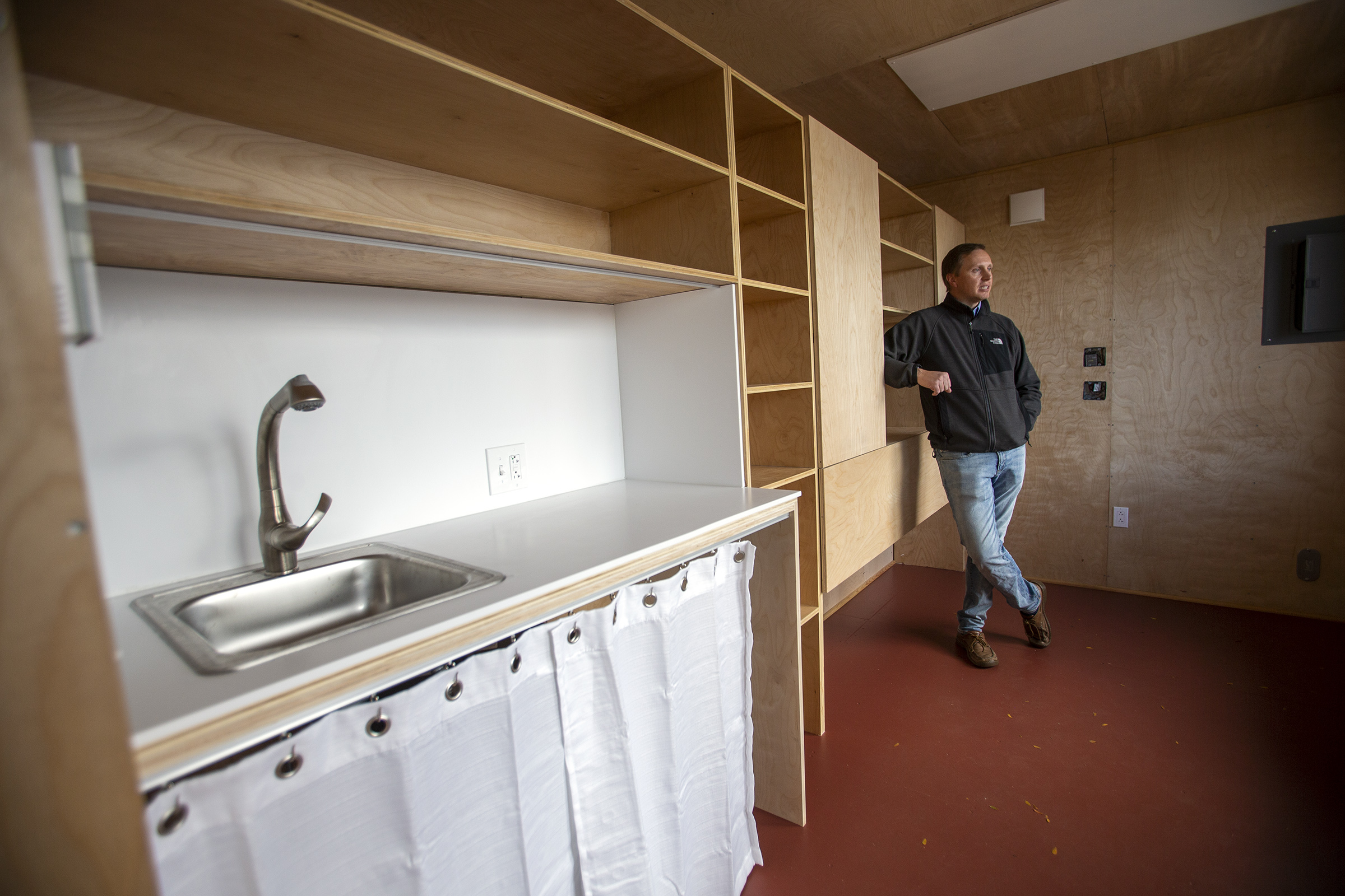 Jeff Tuft,an associate at Architectural Nexusin Salt Lake City, shows off the125-square-foot tiny homethe company built for a Seattle-based project aimed at ending homelessness on Tuesday, Oct. 29, 2019. The home will be delivered to Seattle in the next few days.