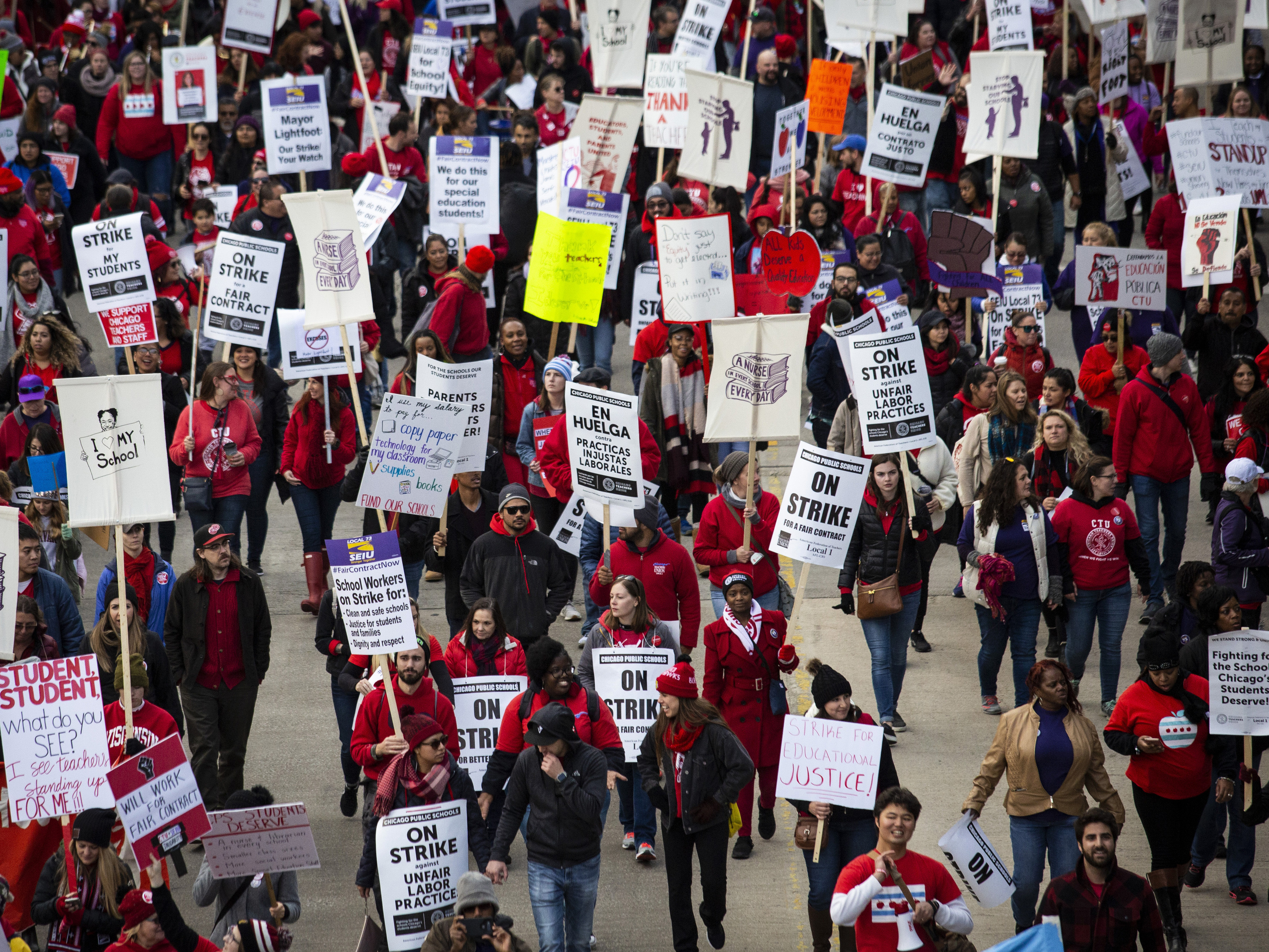 Thousands of striking Chicago Teachers Union members and their supporters march through the Loop on the first day of the strike on Oct. 17, 2019.