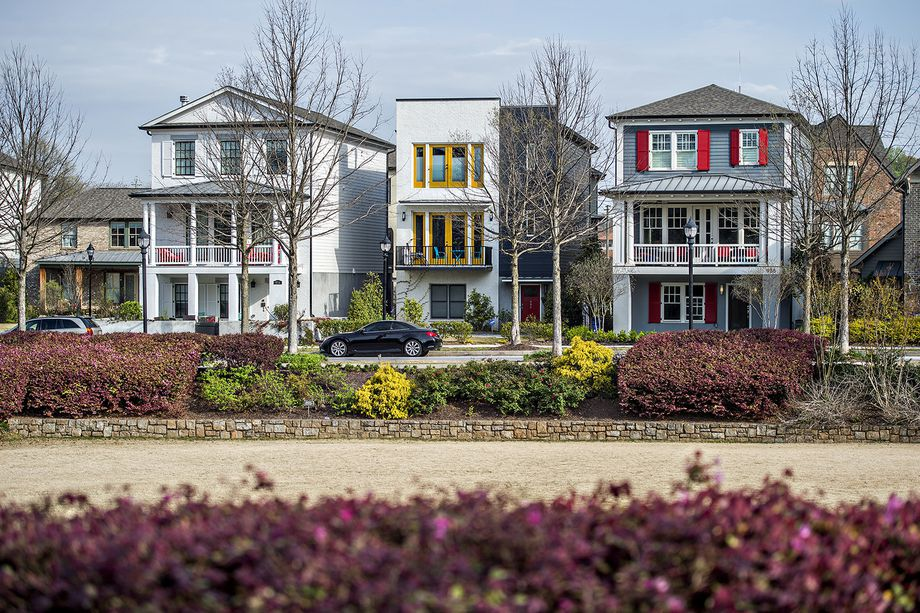 A row of three colorful houses fronting a park in Atlanta.