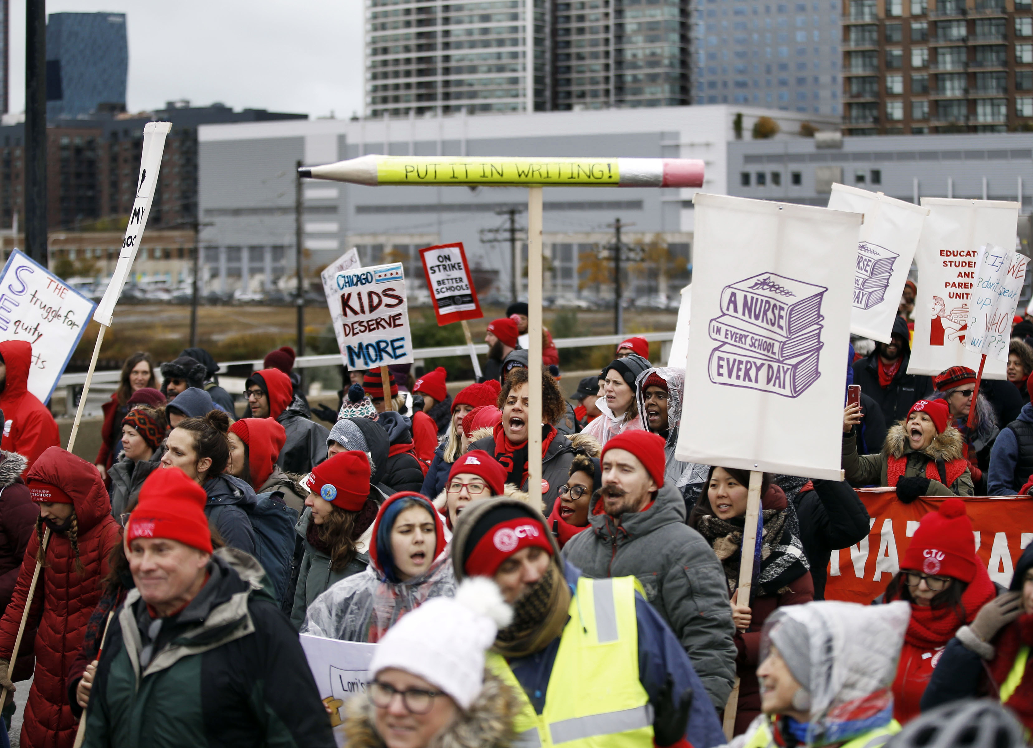 The Chicago Teachers Union rally shut down westbound Roosevelt Road, Wednesday, Oct. 30, 2019, in Chicago. (Kevin Tanaka/Chicago Sun-Times via AP) ORG XMIT: ILCHS332