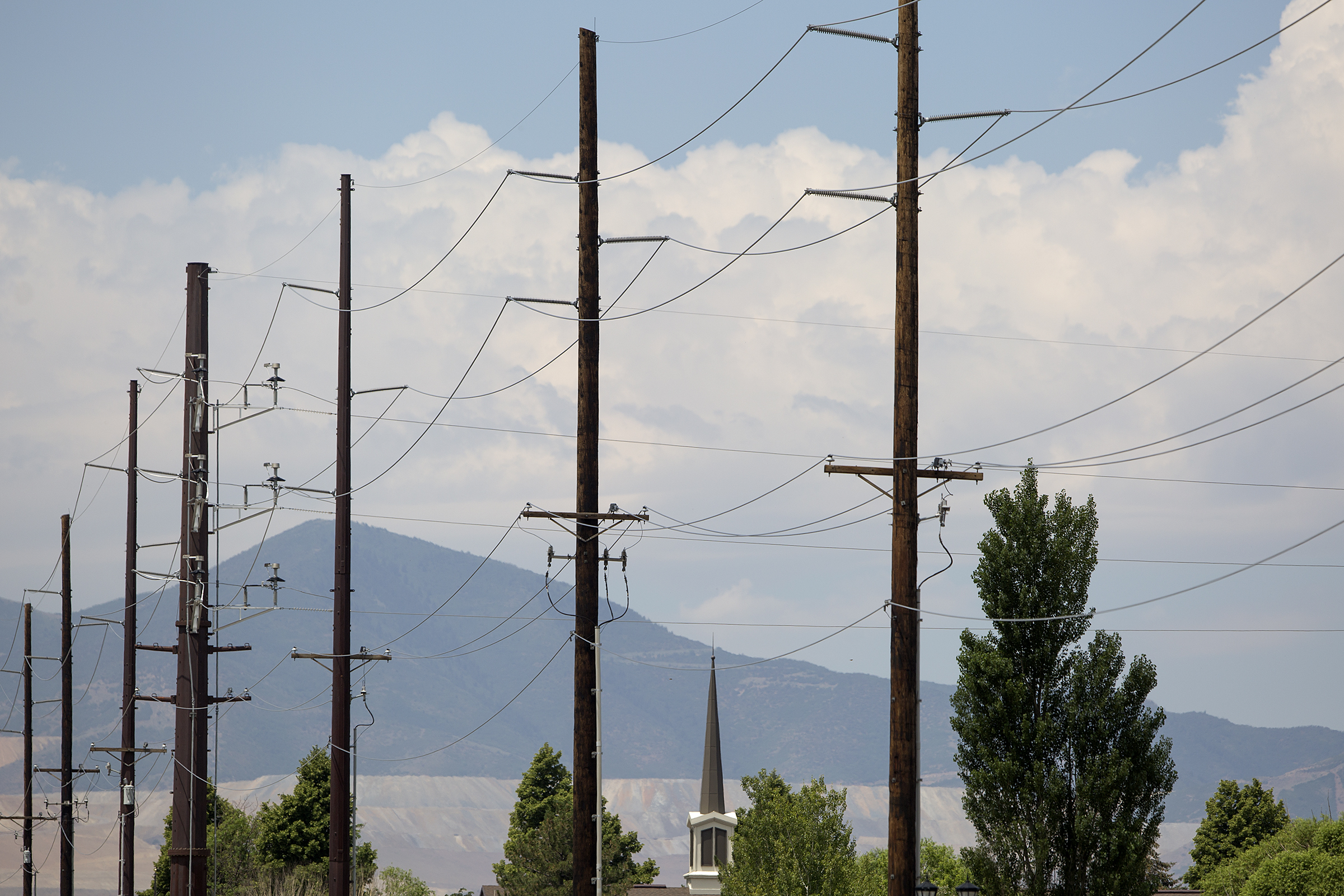 Power lines run along 11400 South in South Jordan on Monday, July 16, 2018. Residents are upset about Rocky Mountain Power's planned upgrade to the transmission poles, which will be taller and carry more power. The project is set to be completed in 2020.