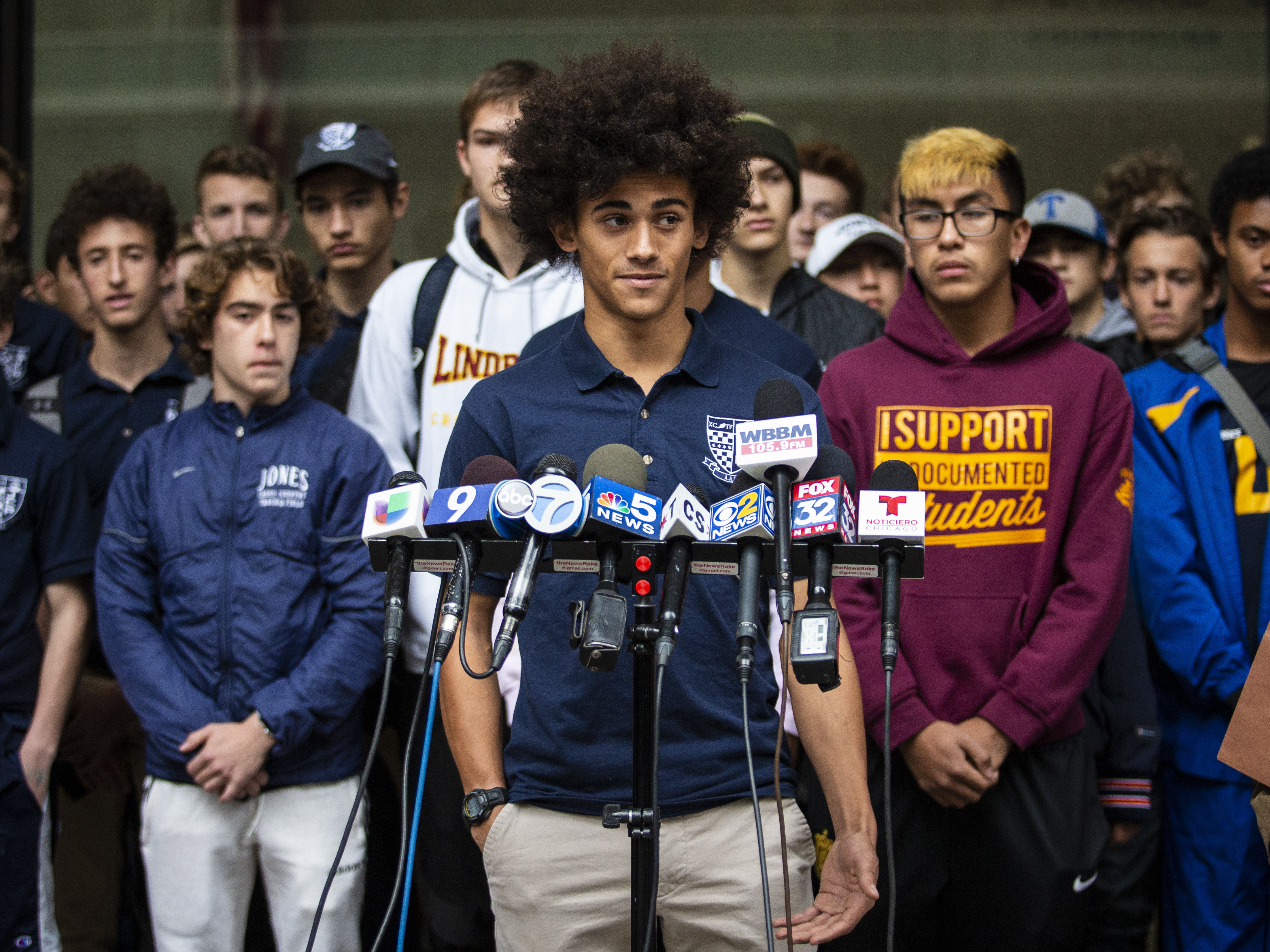 Ian Bacon, a senior at Jones College Preparatory High School who runs cross country, speaks during a press conference outside the Daley Center.