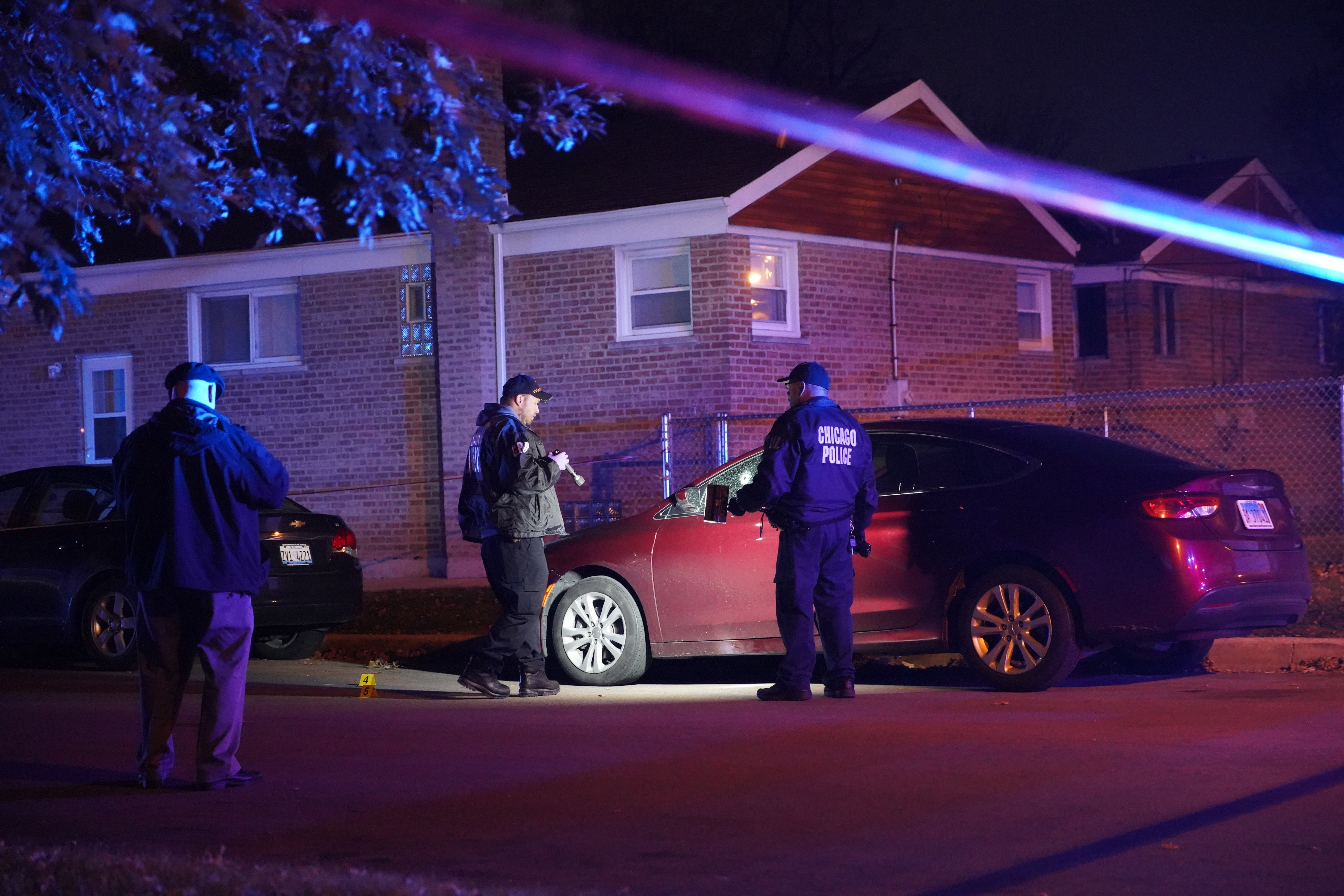 Chicago police investigate the scene where a woman was shot in a car Nov. 4, 2019, in LeClaire Courts.