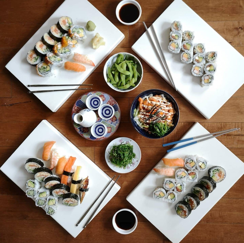 Plates of sushi arranged geometrically.