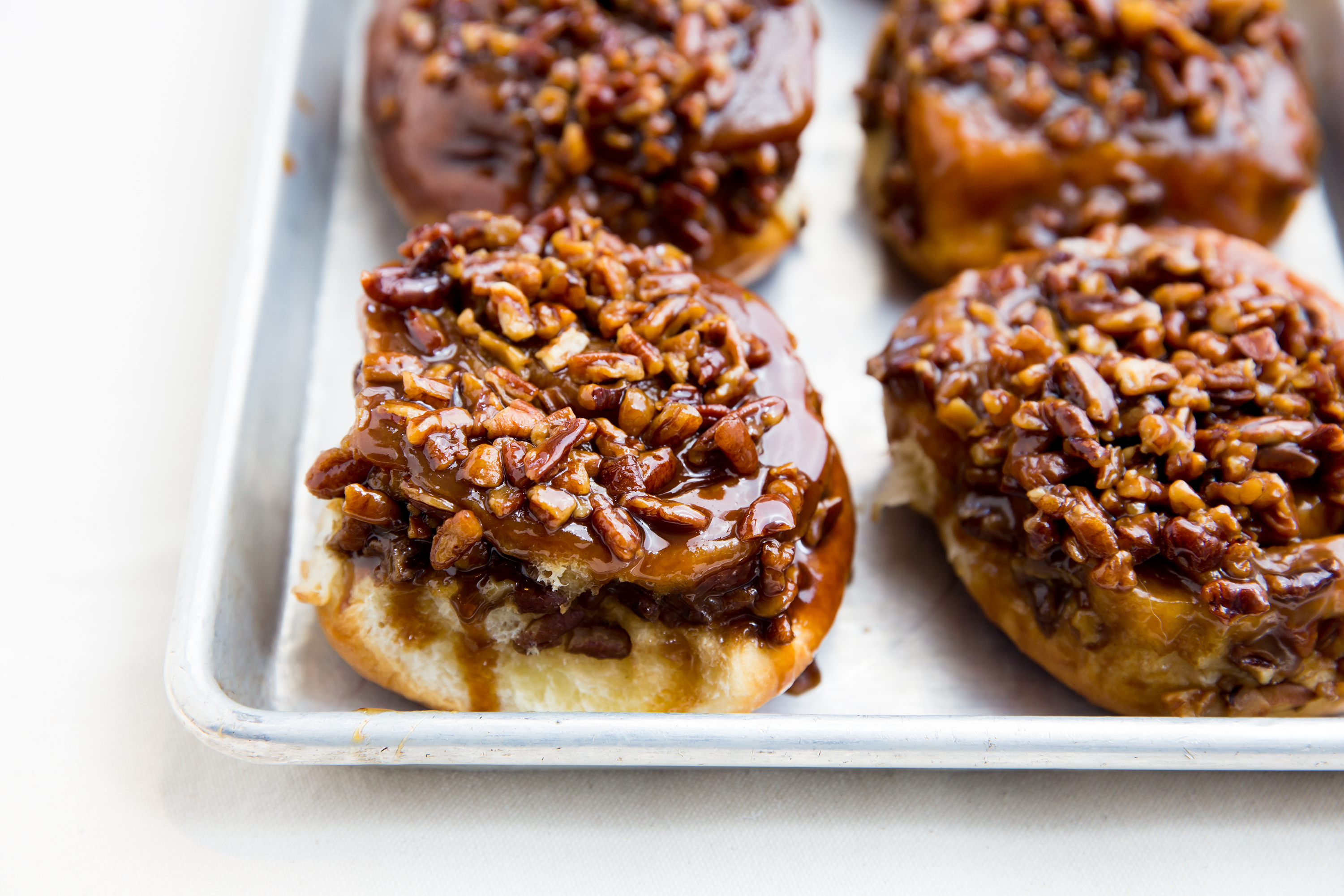 A pan with pecan-covered sticky buns