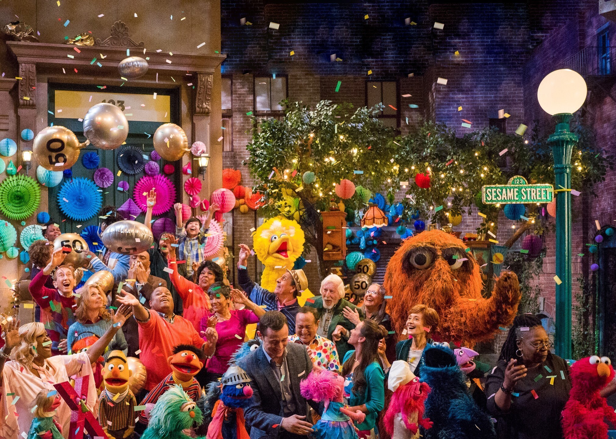 """This image released by HBO shows the cast of """"Sesame Street"""" during a celebration of their 50th season of the popular children's TV show."""