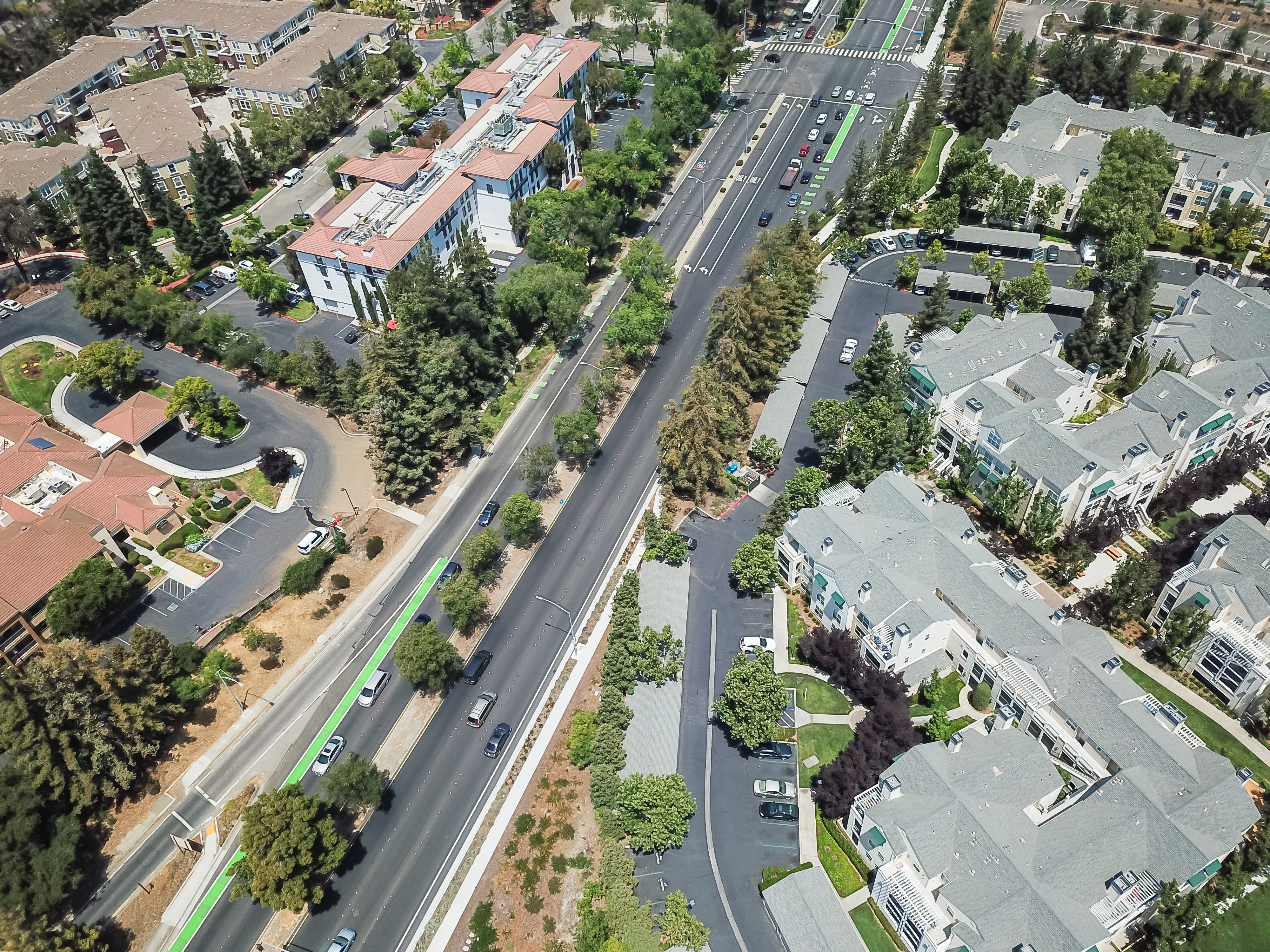 View of streets and one-story homes from above.