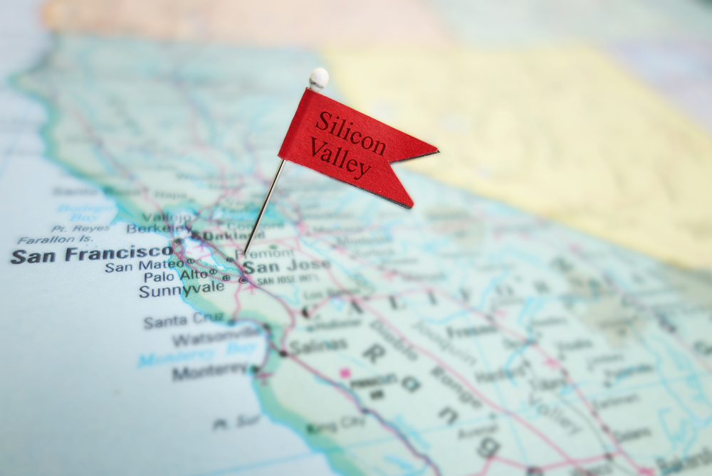 "A small red flag labeled ""Silicon Valley"" stuck in a map of California."