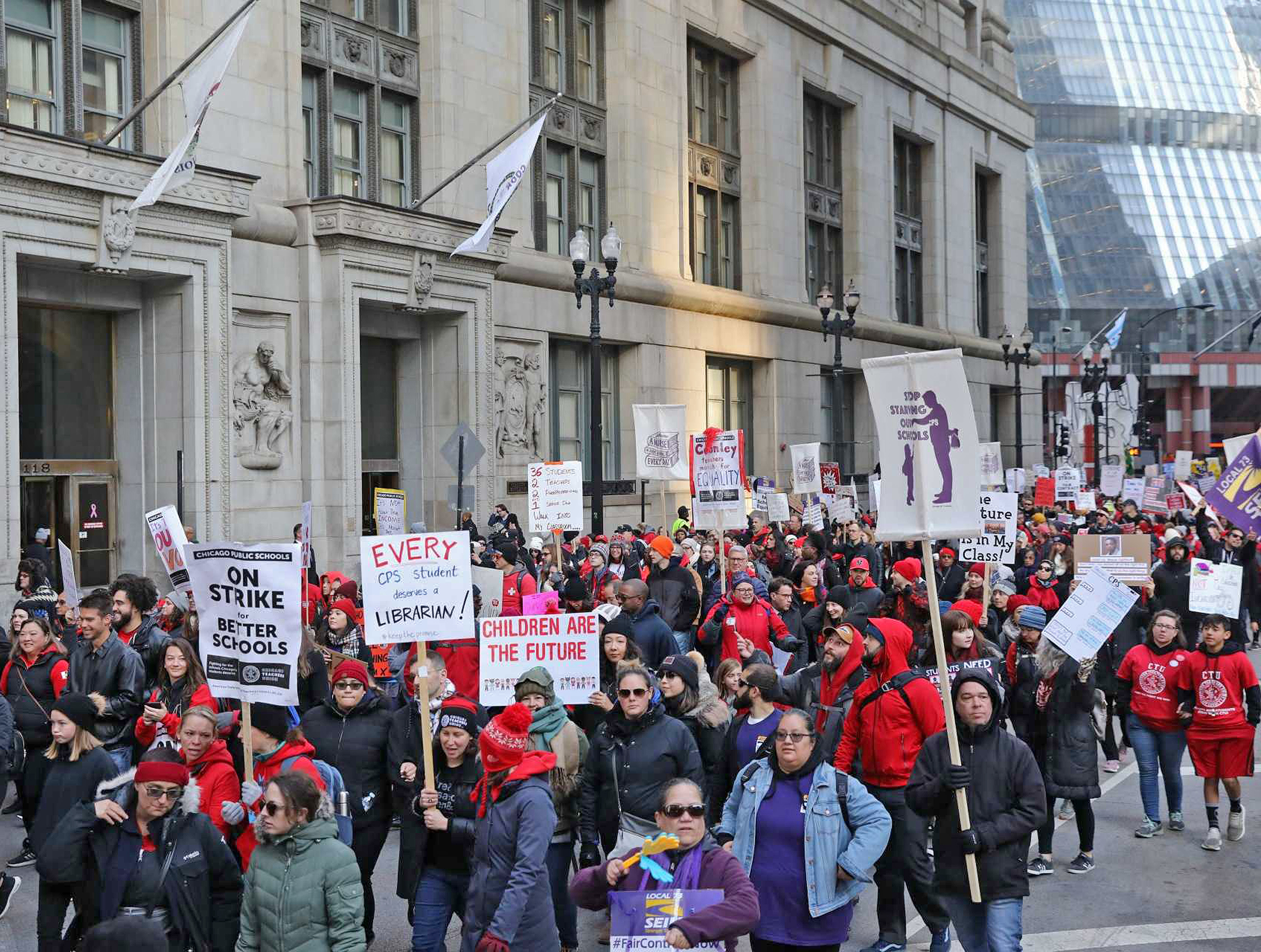 Striking Chicago Teachers Union members march outside City Hall on Wednesday morning.