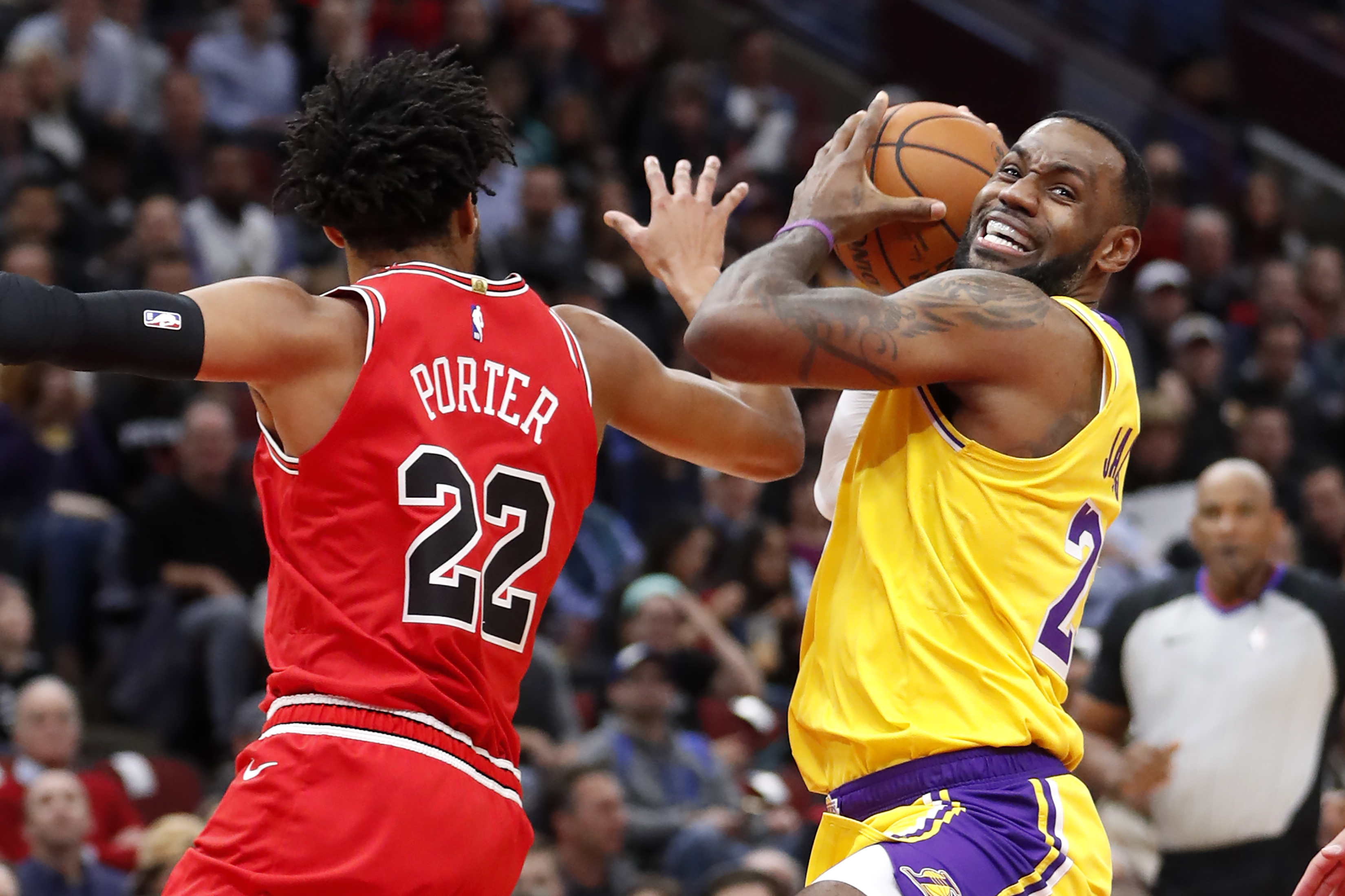 The Lakers' LeBron James drives to the basket past the Bulls' Otto Porter Jr. Tuesday at the United Center.
