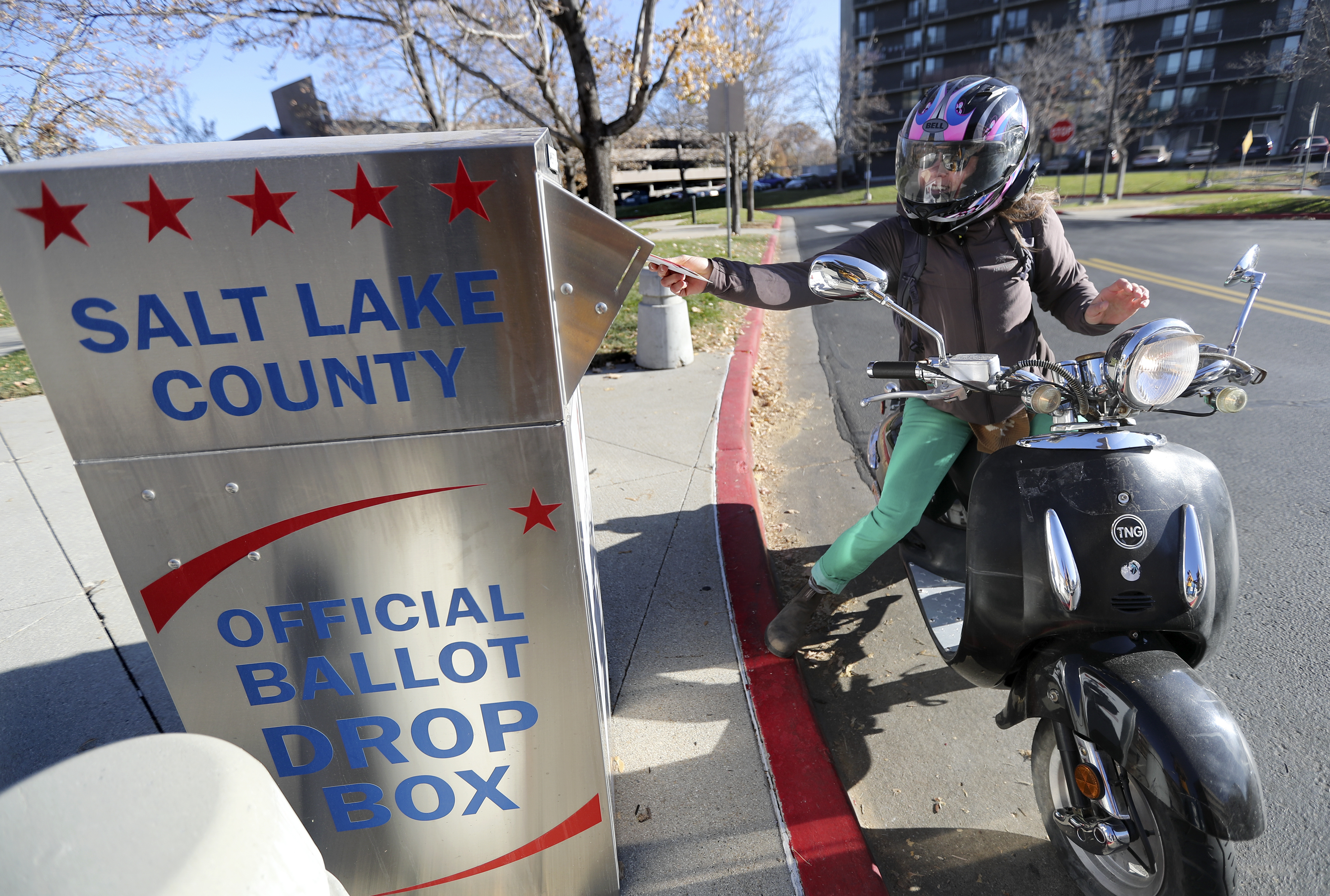 Maddie Kaminski drops her election ballot off outside of the Salt Lake County Government Center in Salt Lake City on Tuesday, Nov. 5, 2019.