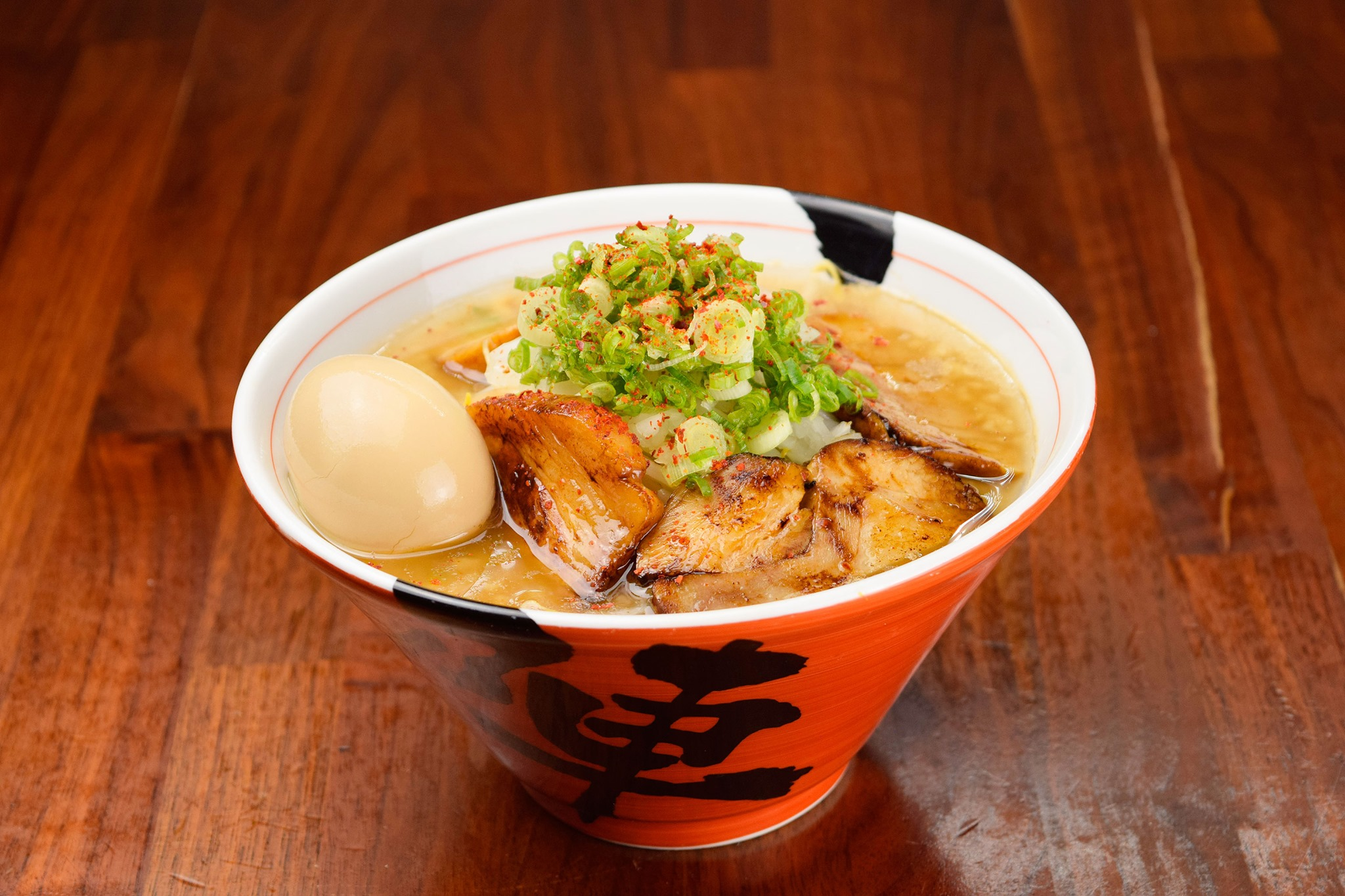 A red bowl containing Jinya's Cha Cha Cha ramen