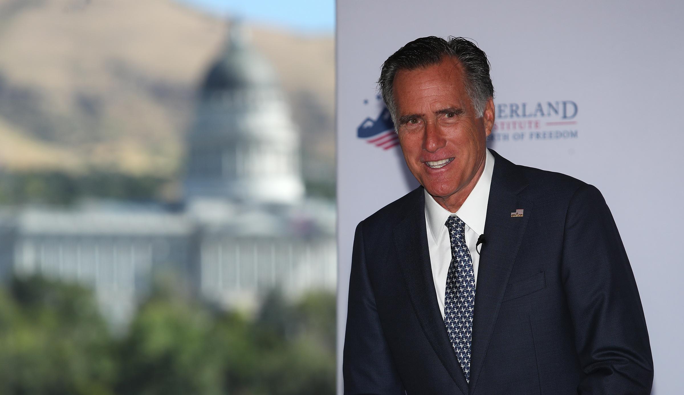 FILE - Sen. Mitt Romney, R-Utah, speaks at the Sutherland Institute in Salt Lake City on Monday, Aug. 19, 2019.