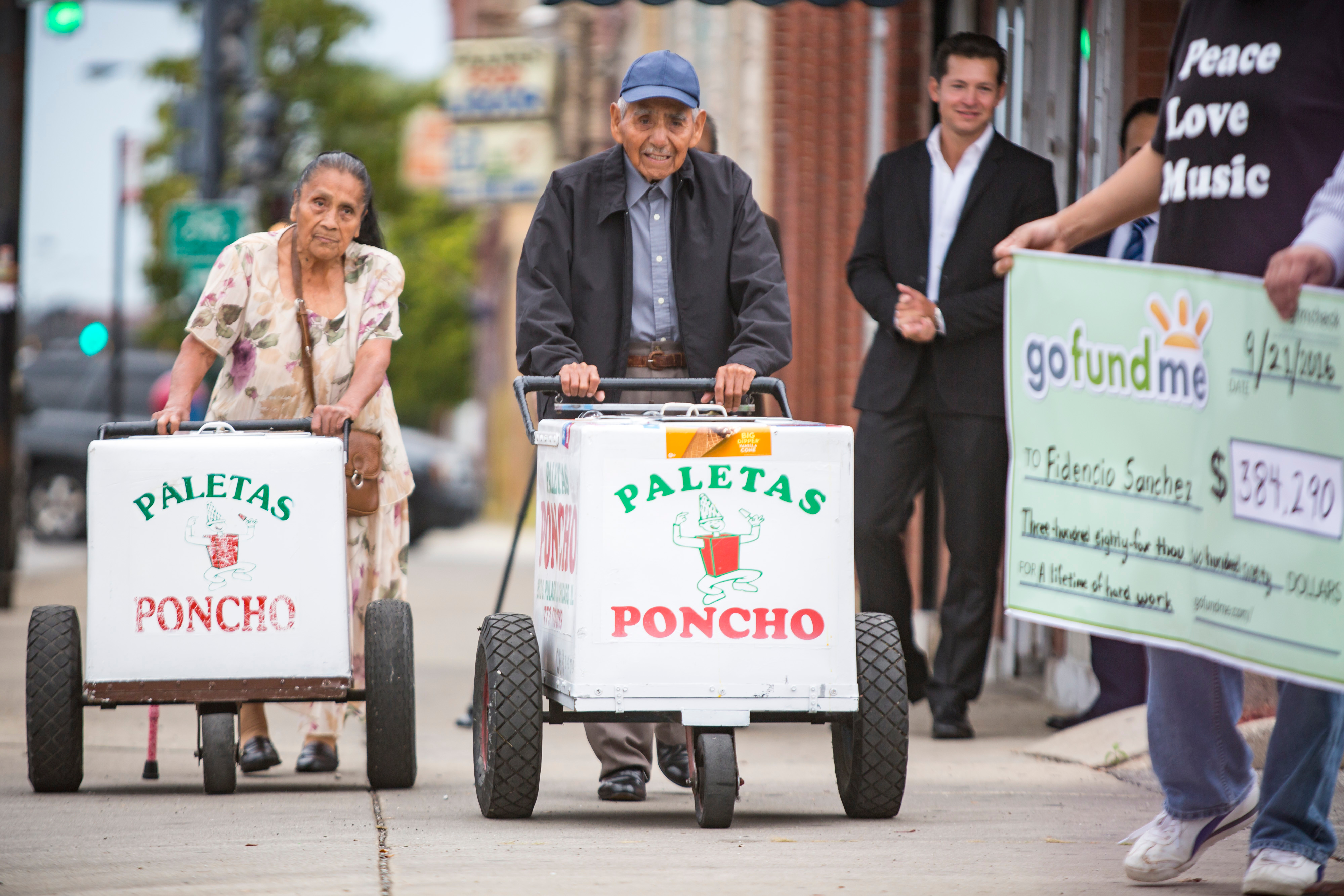 Fidencio Sanchez, center, with his wife Eleatia, at a ceremony to accept a check for $384,290 raised through a GoFundMe campaign in 2016.