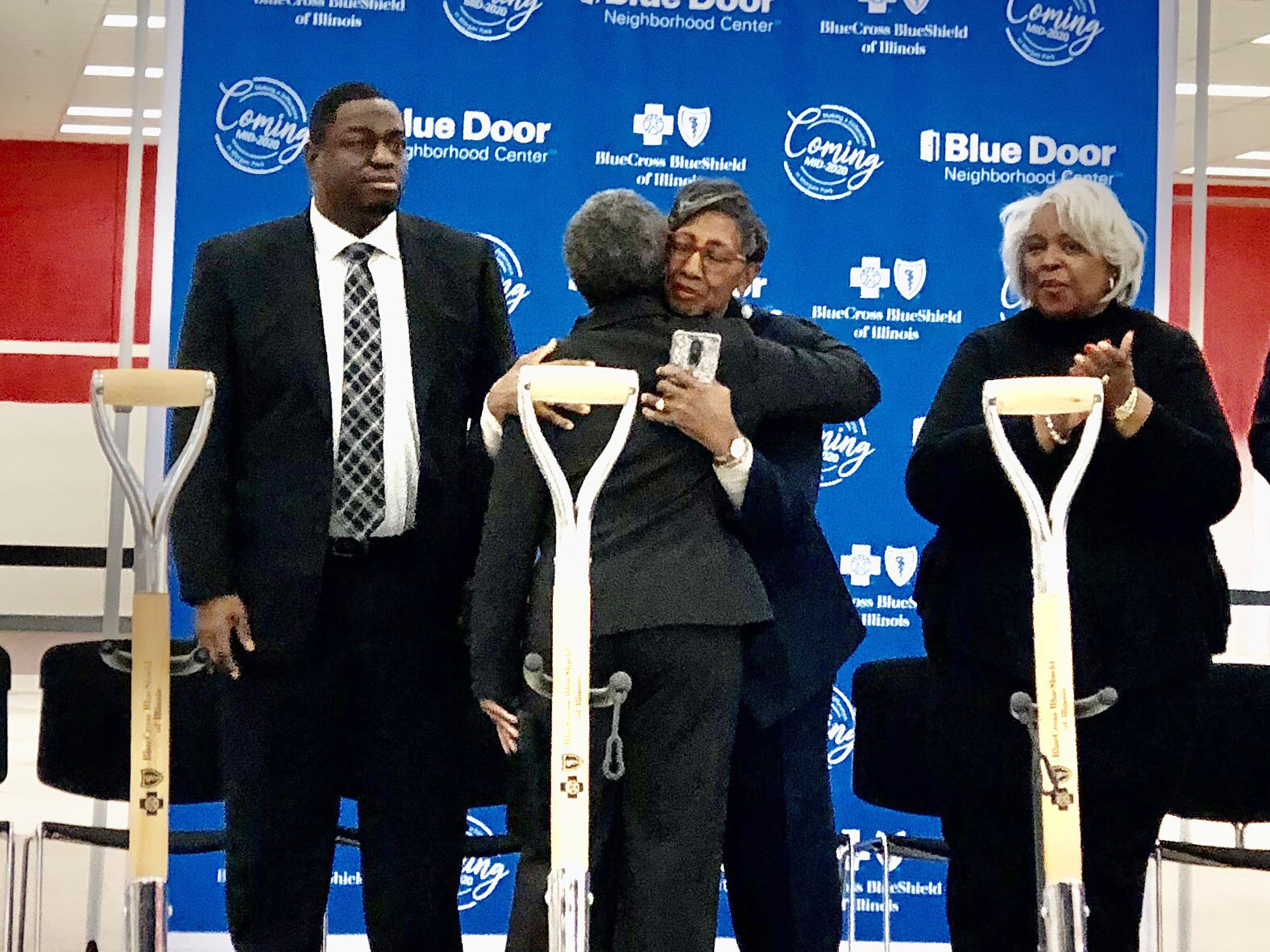 Mayor Lori Lightfoot hugs Ald. Carrie Austin (34th) at a ceremonial groundbreaking for a new wellness center in Morgan Park.
