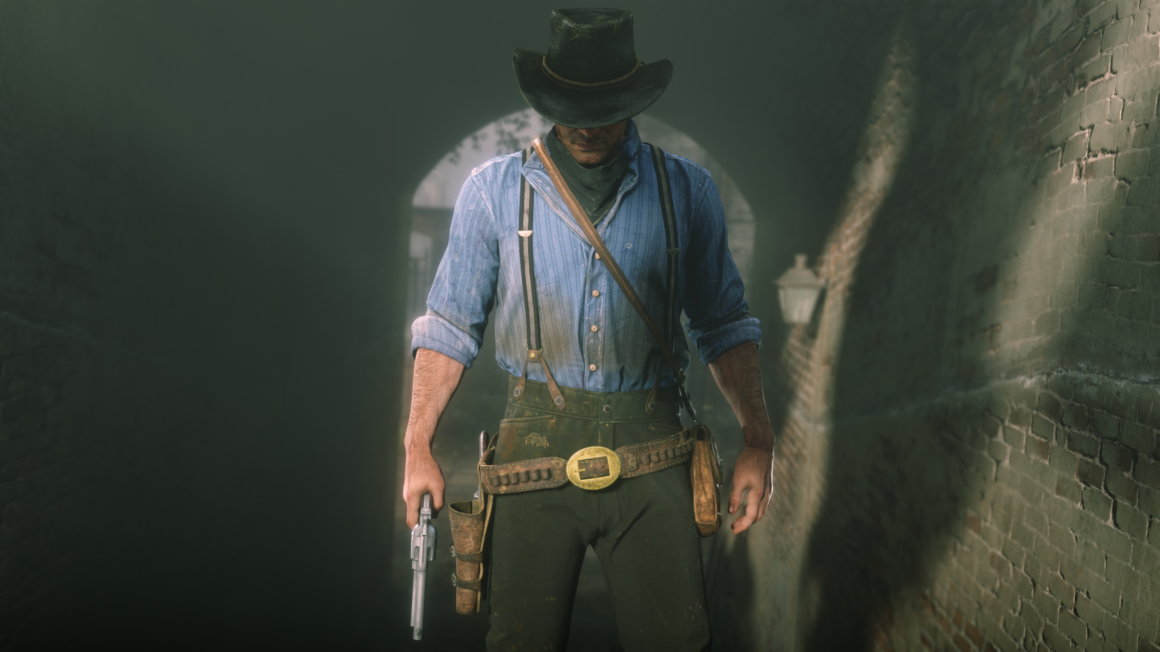 a man wearing a cowboy hat and holding a revolver, Arthur Morgan, looks down while standing on a staircase in Red Dead Redemption 2