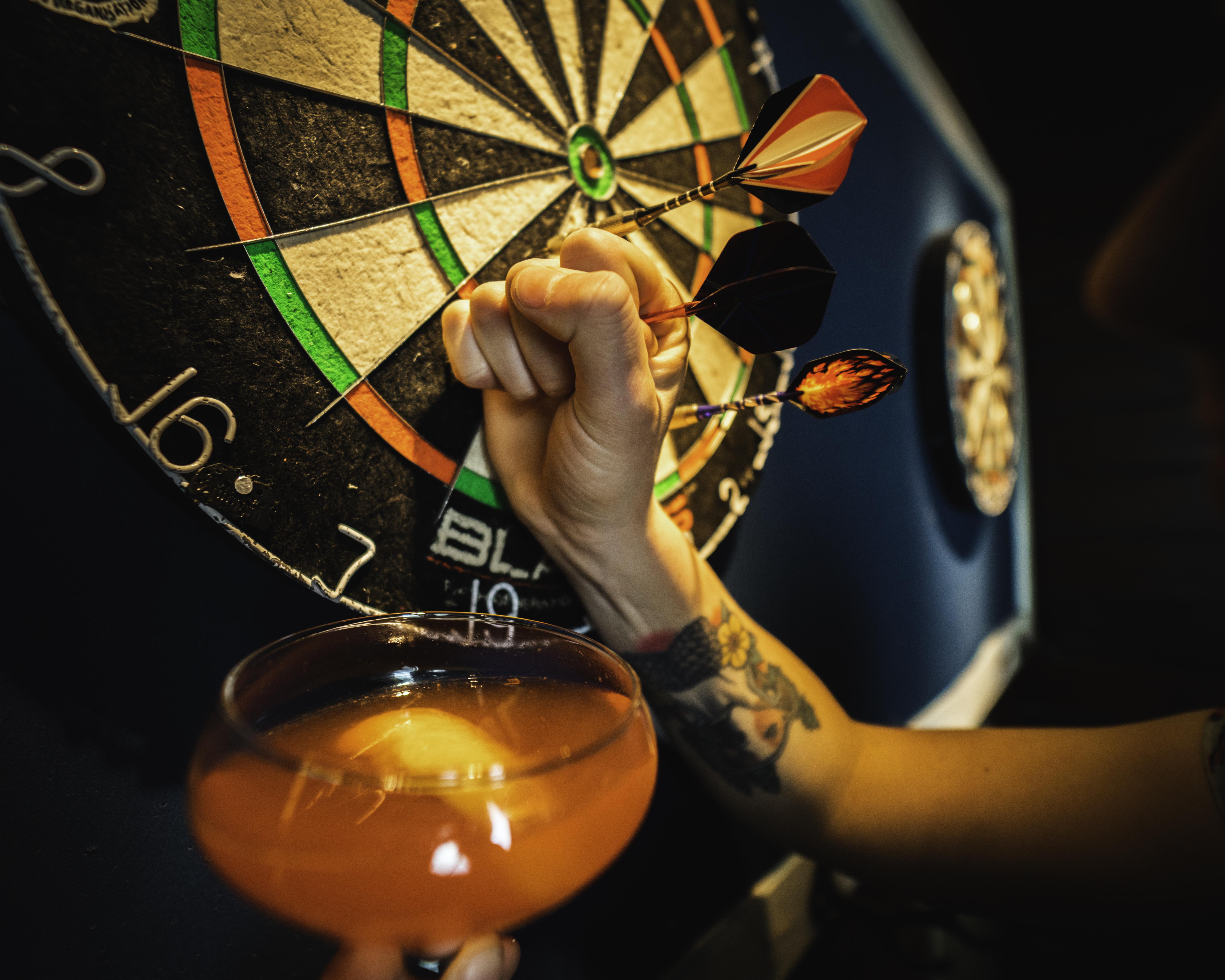 cocktail and dart board at Punch Bowl Social