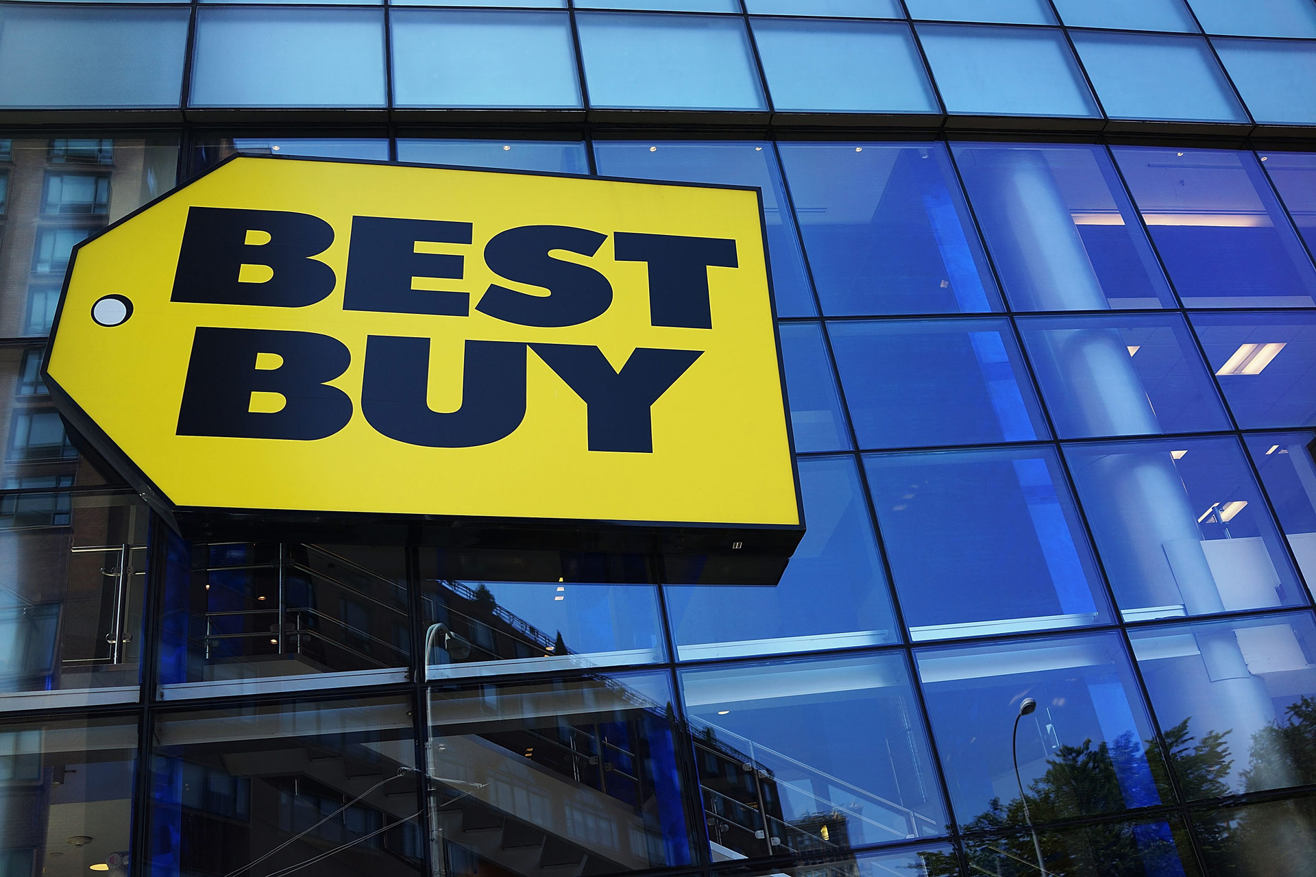 A photo of the Best Buy logo on a store