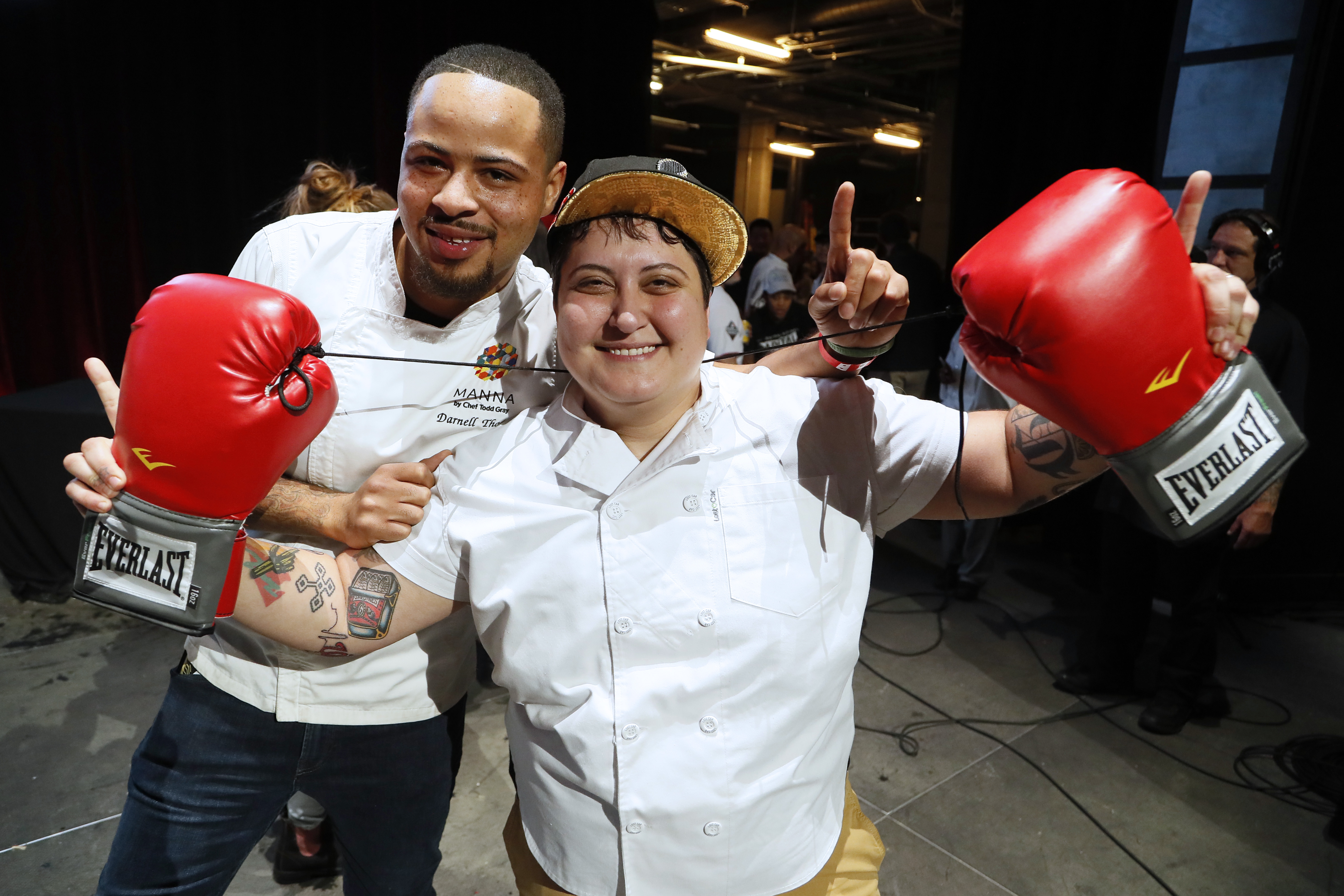 Chef Marcelle Afram celebrates her win Wednesday night at DC Central Kitchen's Capital Food Fight by holding up a pair of boxing gloves.