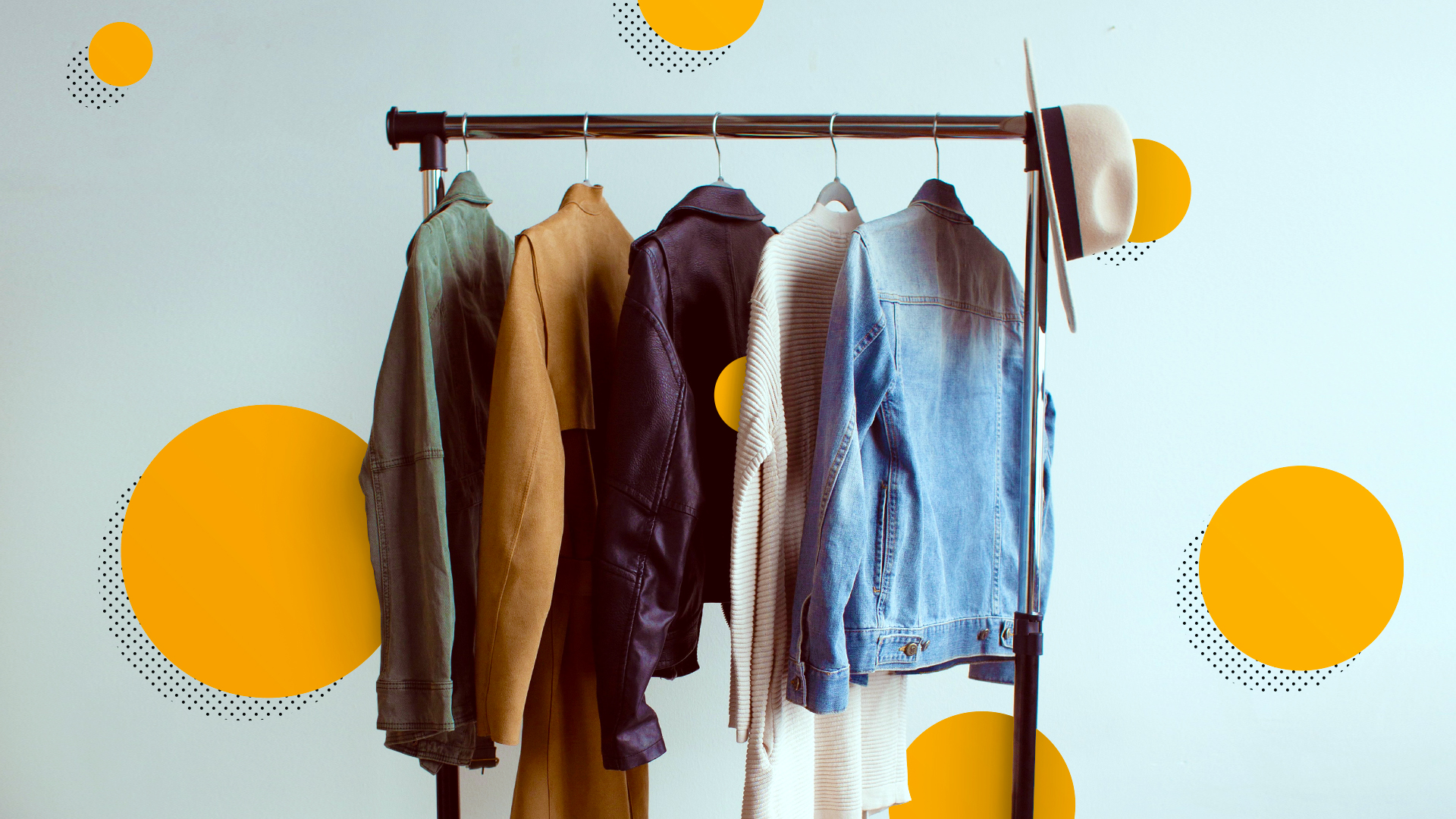 A clothing rack with clothing garments hanging from it surrounded by a circle pattern.