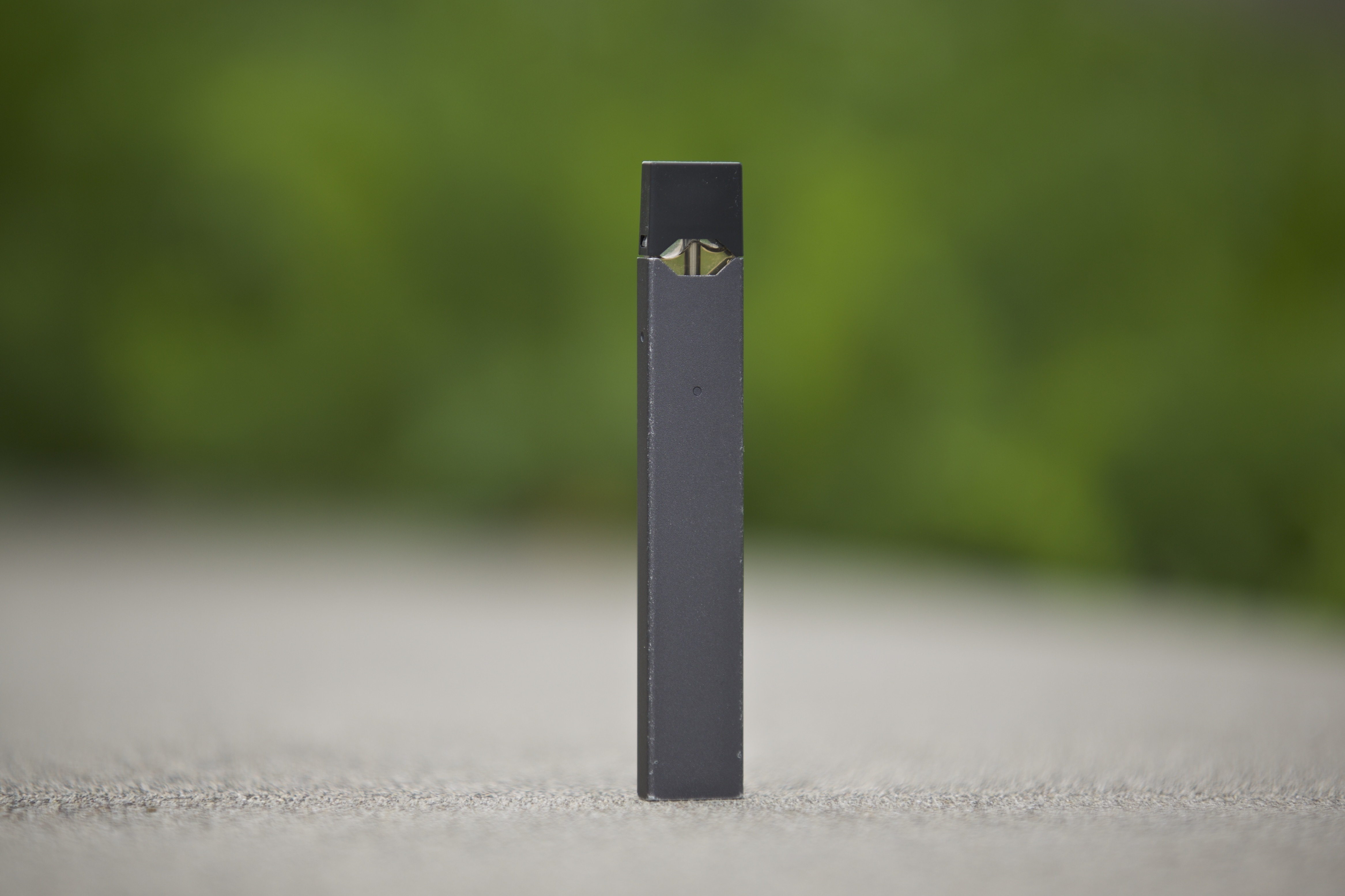 This April 16, 2019 photo shows a Juul vape pen in Vancouver, Wash. The company's rise coincided with an explosion of underage vaping by teens. As regulators and lawmakers scramble for solutions, few are talking about Juul's defining feature: a high-nicot