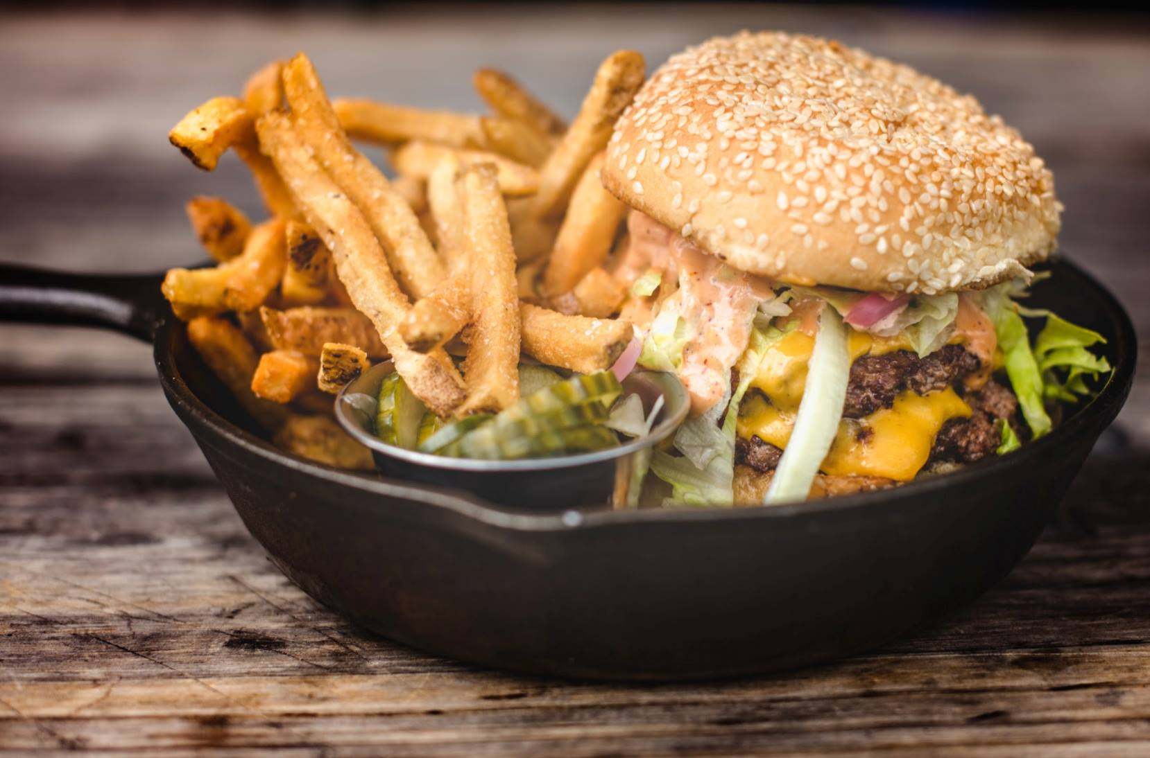 Burger and fries at Punch Bowl Social