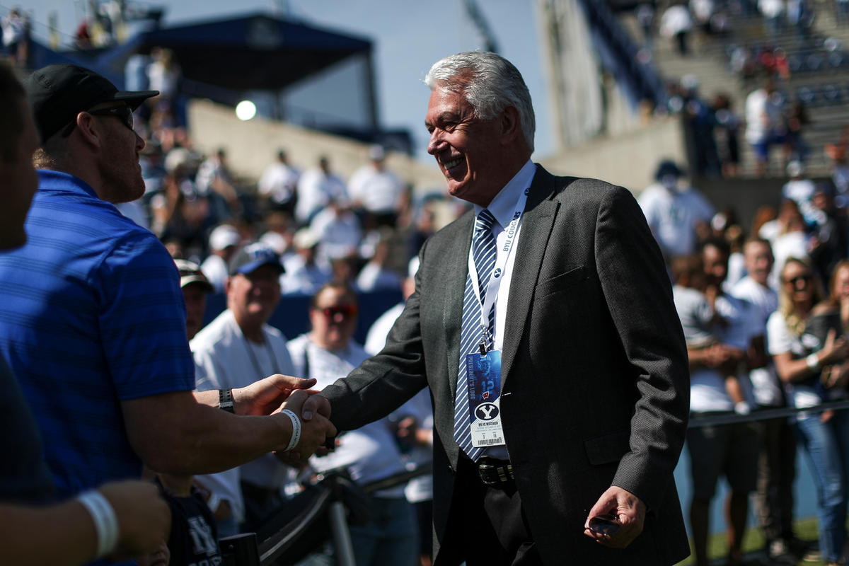 Dieter F. Uchtdorf, third counselor to the First Presidency of the Church of Jesus Christ of Latter-day Saints, greets fans before the game between the Brigham Young Cougars and the Wisconsin Badgers at LaVell Edwards Stadium in Provo on Saturday, Sept. 1