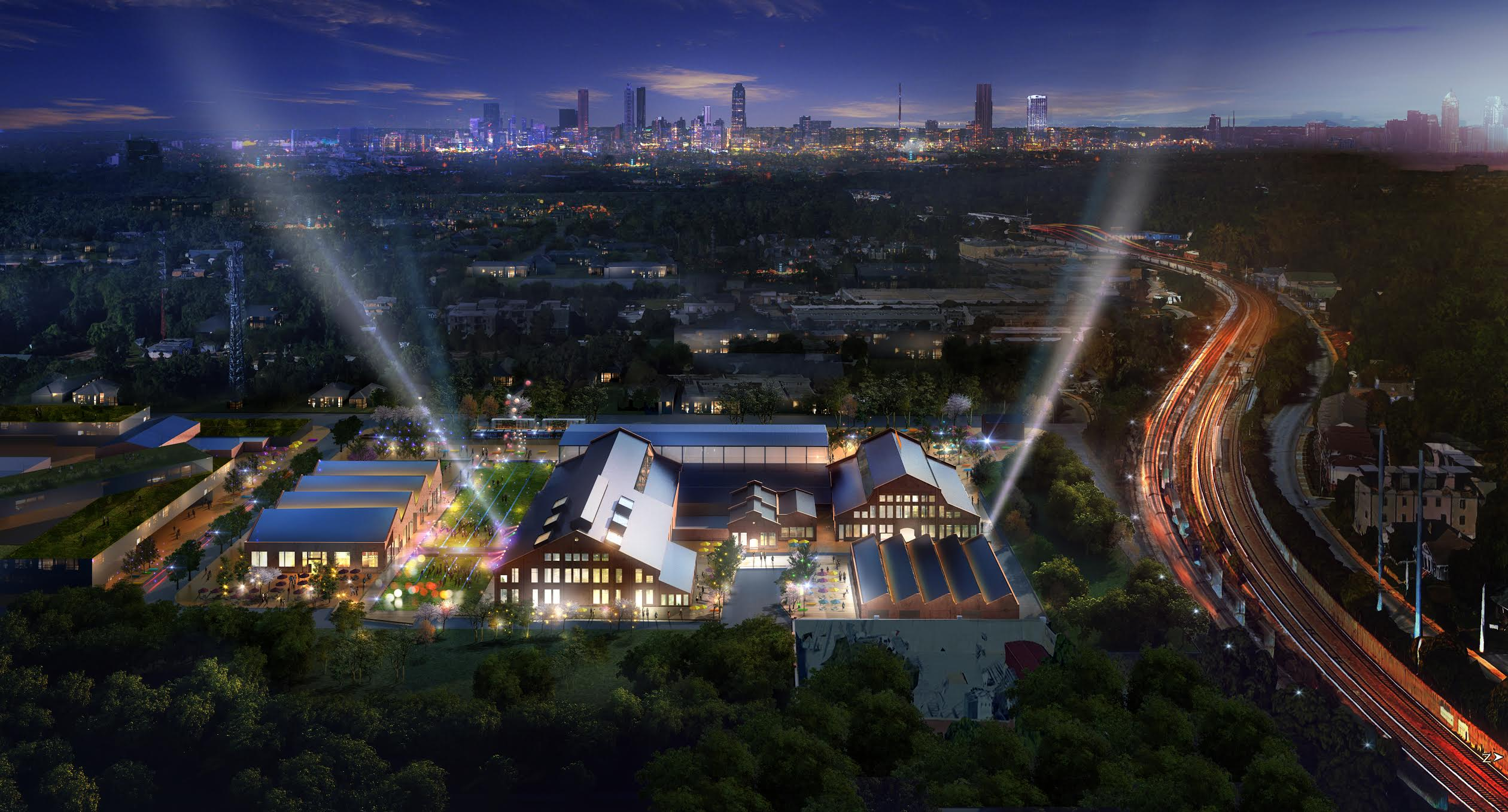 Rendering of entertainment district lit up at night with Atlanta in the background.