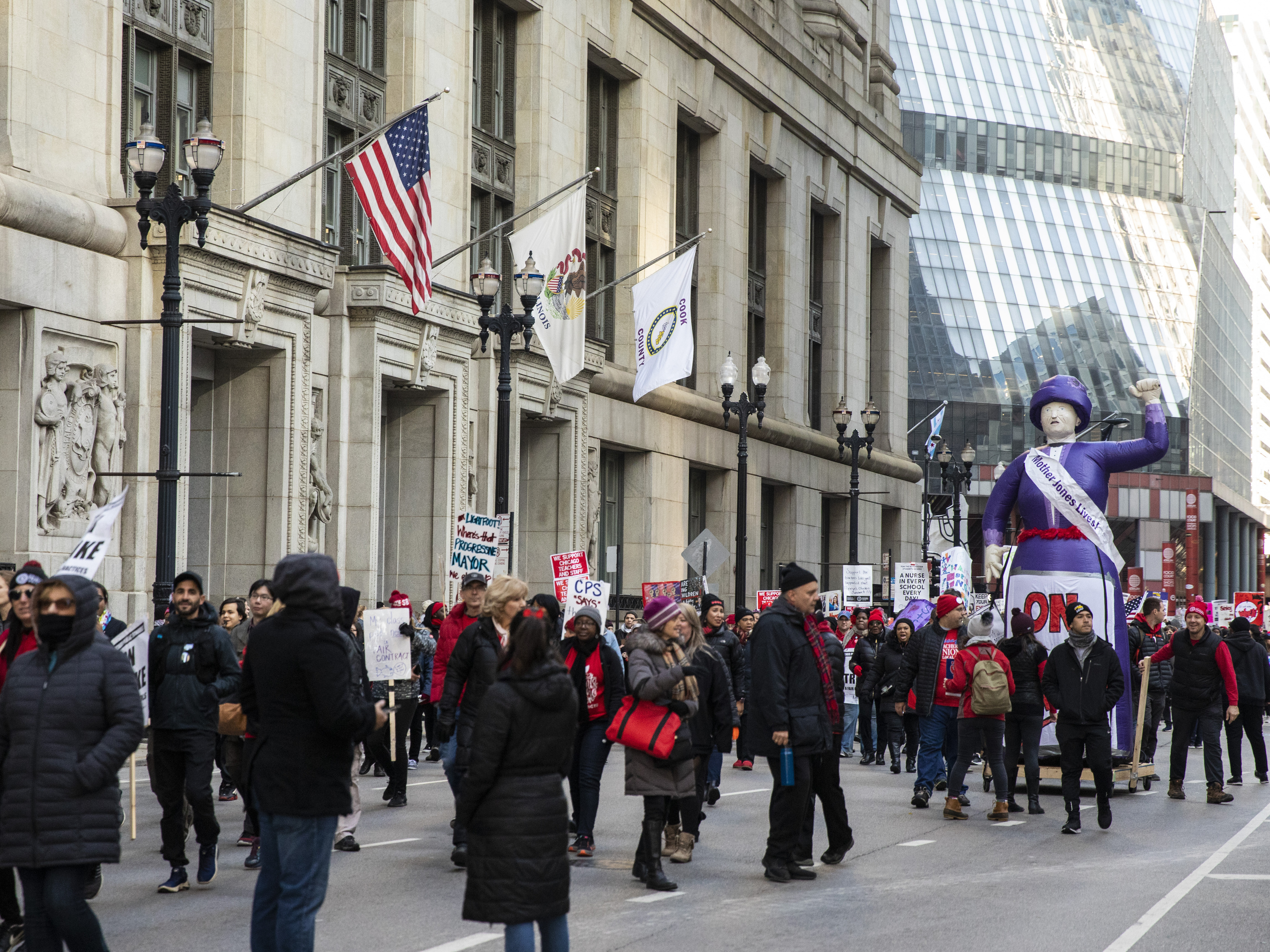 Thousands of striking Chicago Teachers Union and their supporters march at City Hall on Oct. 23.