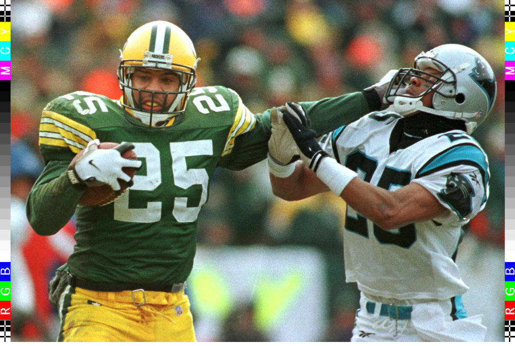 Dorsey Levens (L) of the Green Bay Packers pushes