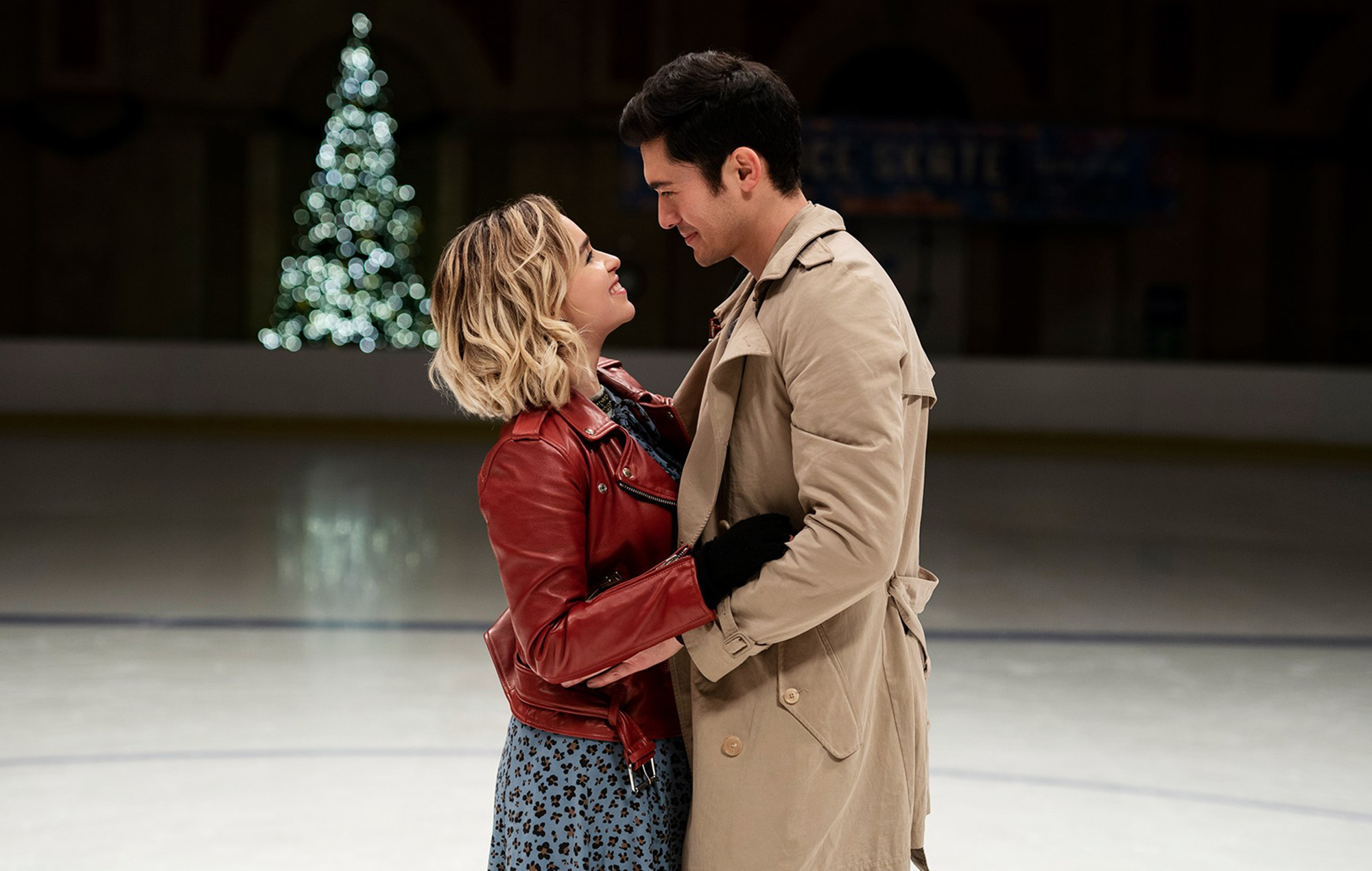 Kate (Clarke) and Tom (Golding) embrace in an ice rink.